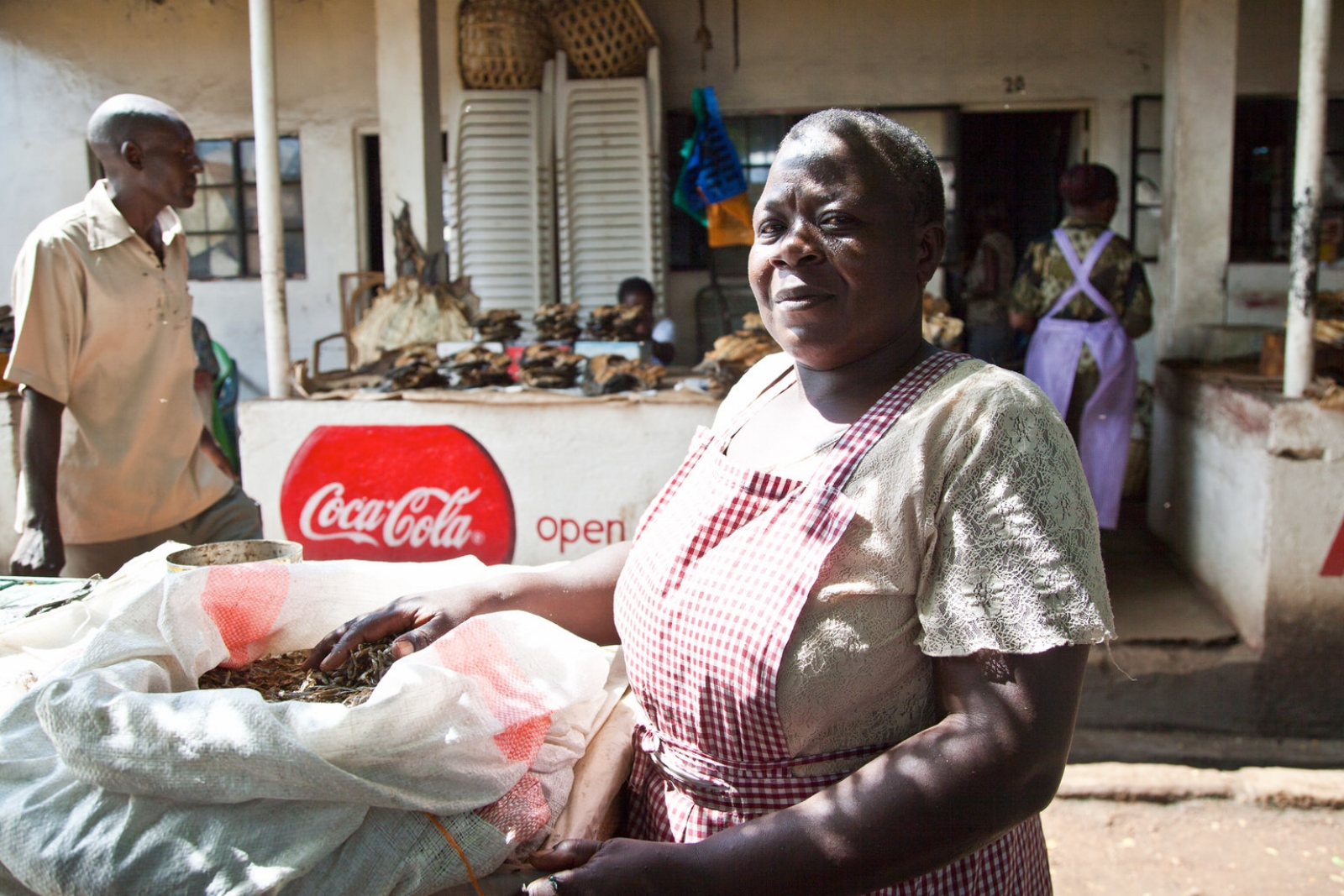 Dorothy  was forcibly relocated from Oile market. After its destruction she found herself at Jubilee market. Dorothy is now supporting thirteen children, many foster children from other family members who have died.