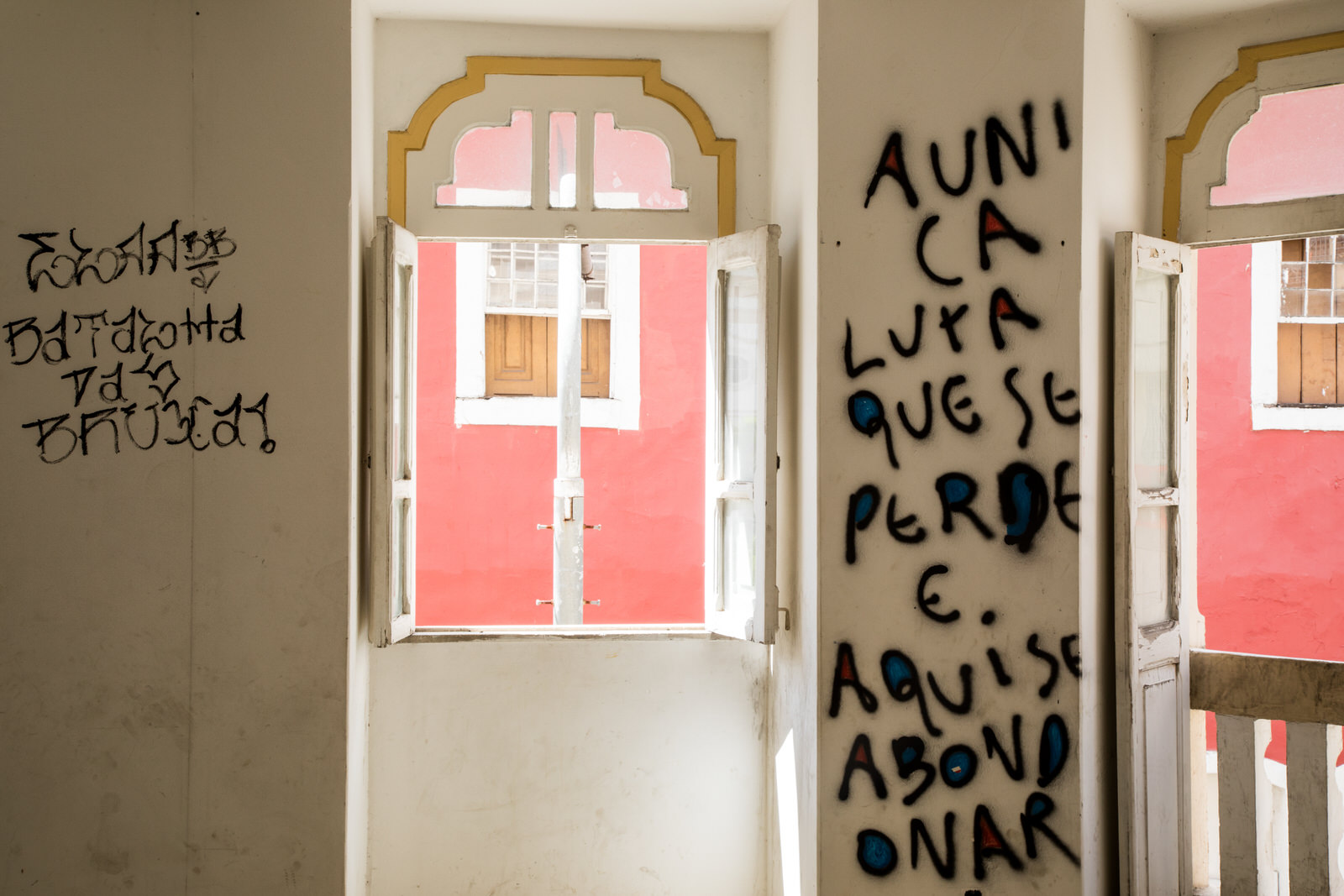 """""""The only fight that is lost is the one that is abandoned"""" . A quote from Marxist Brazilian writer Carlos Marighella is scrawled on the wall. Marighella was born in Salvador."""