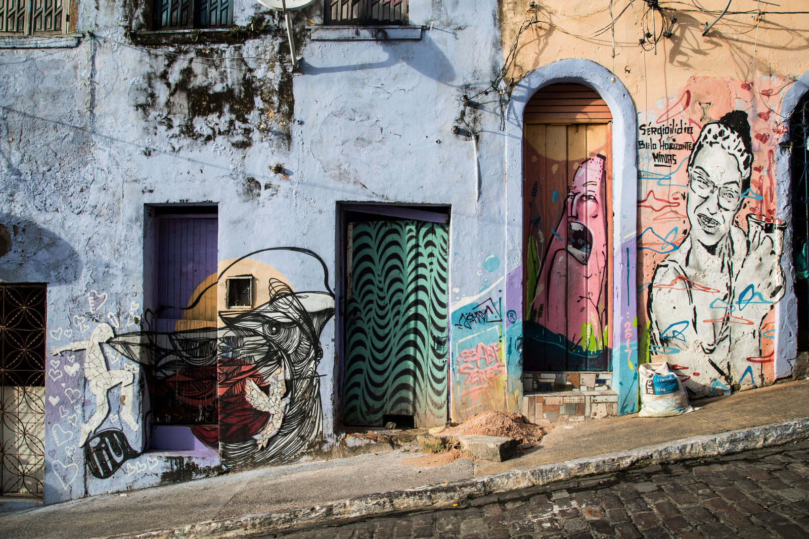 Residents of the community have collectively mobilised to rehabilitate the  Ladeira , reconstructing collapsed mansions and painting decaying façades with colourful graffiti referencing the African Diaspora.