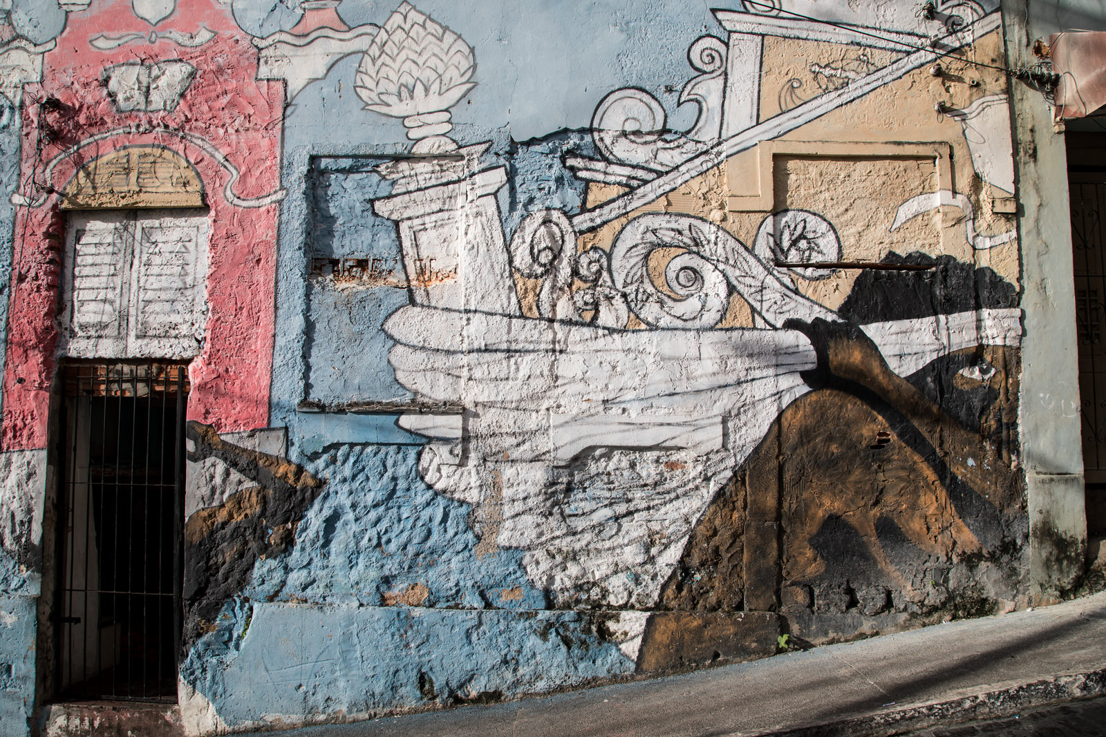 Slave carrying shipments from the lower to the upper city . Grafitti such as this exposes Brazil's institutionalised culture of exclusion as a means to call for the city  to remember  and to claim their housing rights.