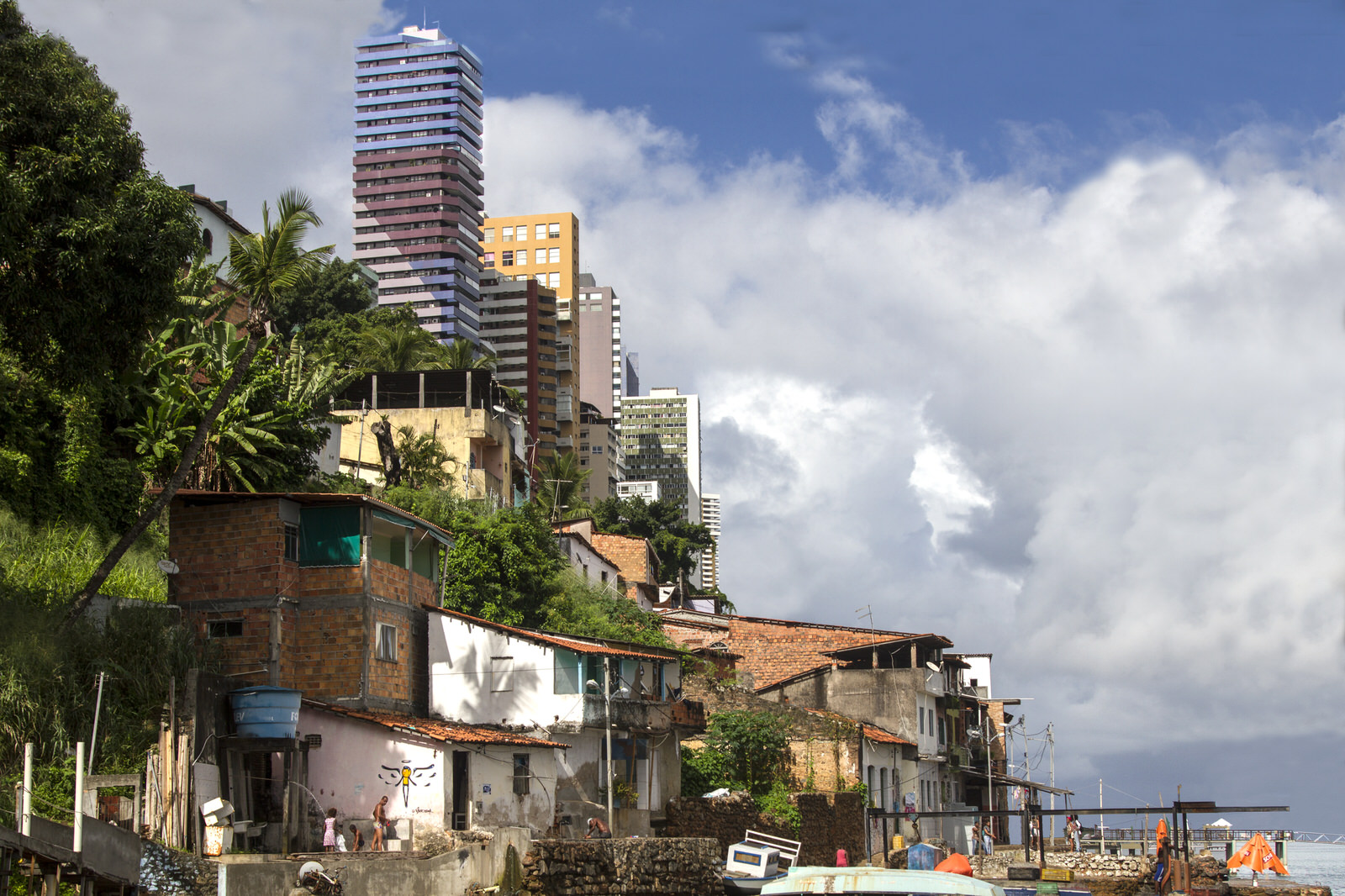Luxury high-rise blocks overlook Gamboa de Baixo. This community has been segregated partly because of the construction of the Avenue Contorno, a large motorway that seperates the community from the city.
