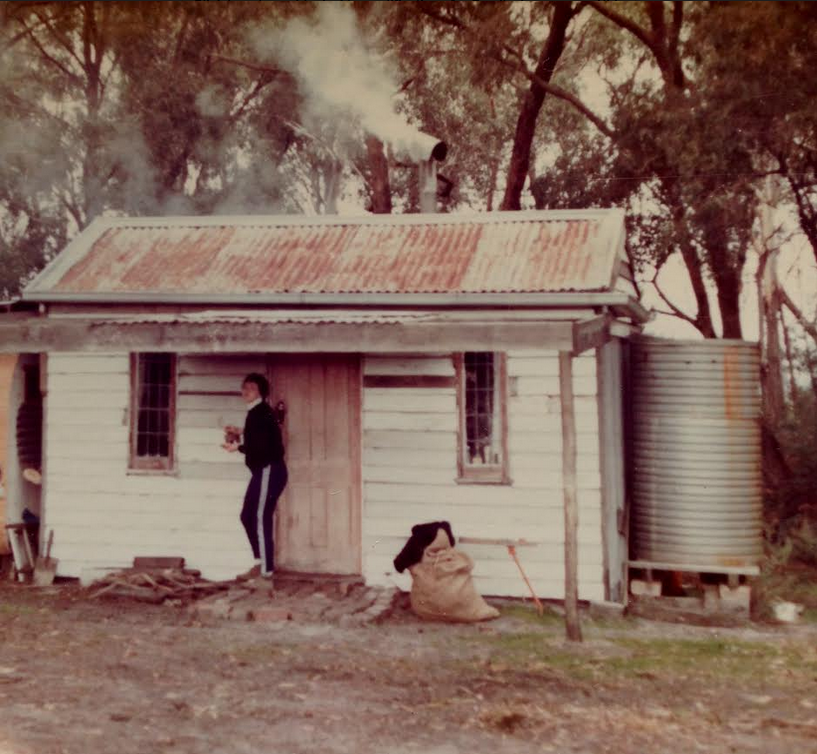 "Late 70's, Lang Lang, Victoria  My mother always dreamed of a little ""getaway bush shack"". So she built this. Yes - that's right. She built this sweet little shack entirely on her own ! Nestled in amongst some eucalypts, this small structure was a cosy place of reading, stories, cooking damper over a fire, writing and imagining.  I remember hearing her talk about the walls, putting on the roof, collecting water for the small tank and all aspects of the structure. Even back then, I knew that I had, and still have, an incredible mother. Rosie is a woman who can shoot a gun, operate farm equipment, build things, recite poetry, cook just about anything over a fire or on a woodfire stove, crack a stockwhip, sew beautiful clothes and this list could go on for a lot longer. Recently retired from a school Principal position, she is a lady with a finely tuned, sharp mind. And on top of this, she has single handedly raised my Downs Syndrome brother Nicholas who is a fine young man.  So as Mother's Day approaches, I am thinking of a suitable gift. And I'm stuck ! My mother has every possible, useful tool / piece of equipment under the sun. Recently at Easter there was talk of ""needing a new wood shed"". No doubt there will a start on this project very soon. My next project at the farm is putting in some new fruit trees.  Looking at this photo reminds me of many sources of inspiration. The picture was taken by me with one of my first cameras - an Agfa with 35mm film. I spent a lot of my pocket money on film and developing pictures. I always remember that long week of waiting to pick the photos up from the chemist, and the excited bike ride down to the shop.  So on the edge of a long weekend, remember the things that inspired you. Or find a satisfying DIY project. Or learn something new.  Enjoy !"