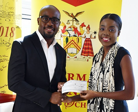 IPCA Director, Kenneth Porter, presents the winning cheque to Brittney Elliot-Williams.