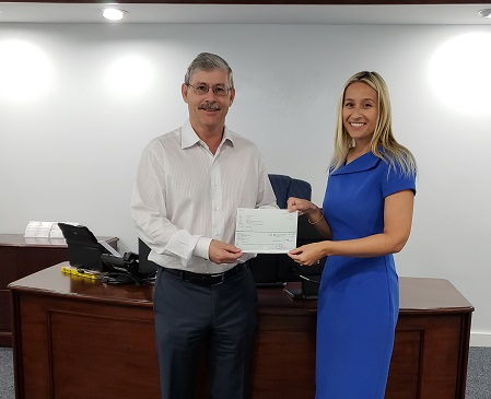 IPCA representative and Essay Competition Judge, Sophie Peat, presents the runner-up cheque to Coilin's father, Sean Flynn, in Coilin's absence.