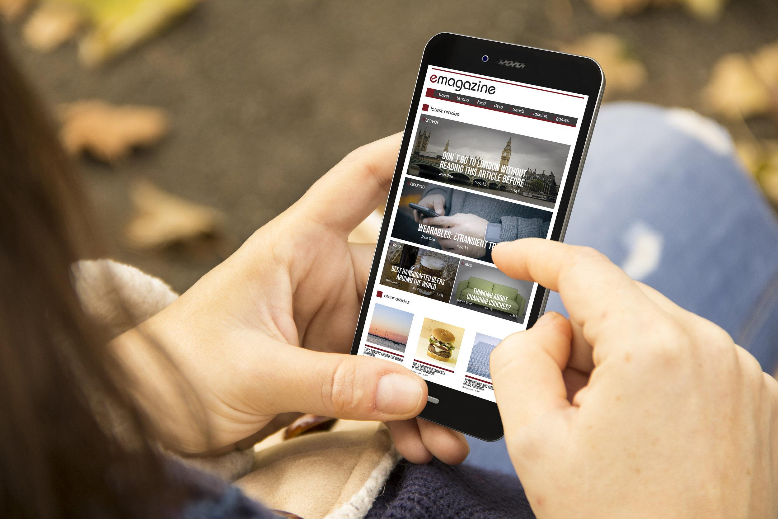 Woman looking at a Koodooweb website on mobile phone.jpg