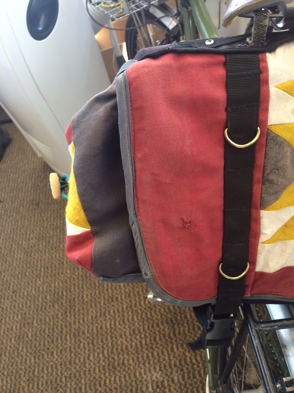 The little scuffs on my saddlebag where it hit the pavement--just enough to add some character.