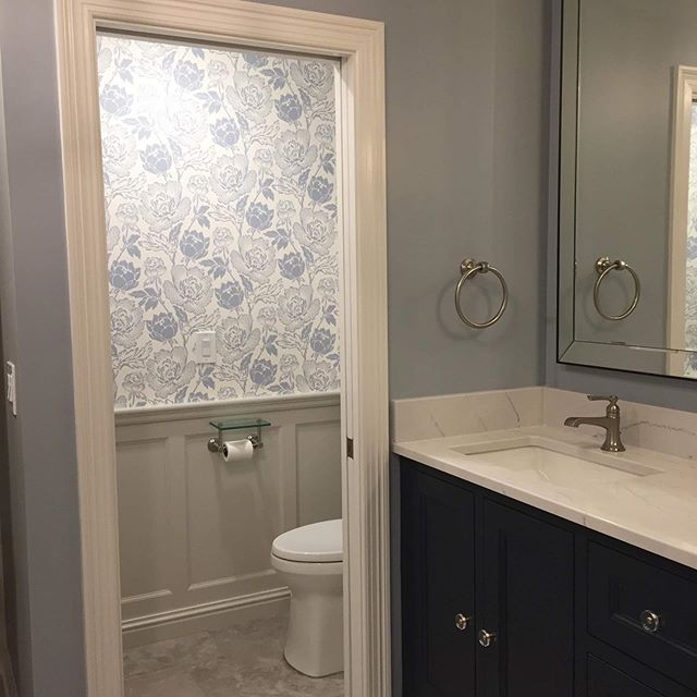 This bathroom transformation seems fitting for today #stl #LGB #wewantthecup #webleedblue #kmdesigns #bathroomdesign #bluecabinets