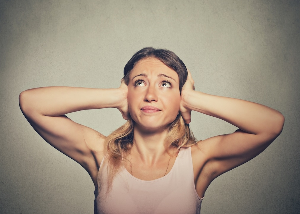unhappy-woman-covering-ears-looking-up-stop-making-loud-noise-492844792_5143x4923.jpg