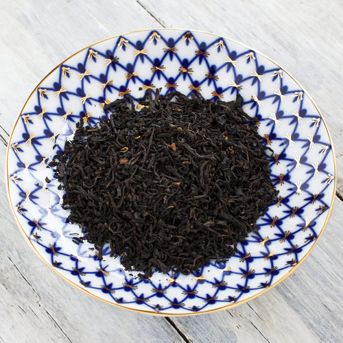 Lapsang Souchong leaves in a saucer