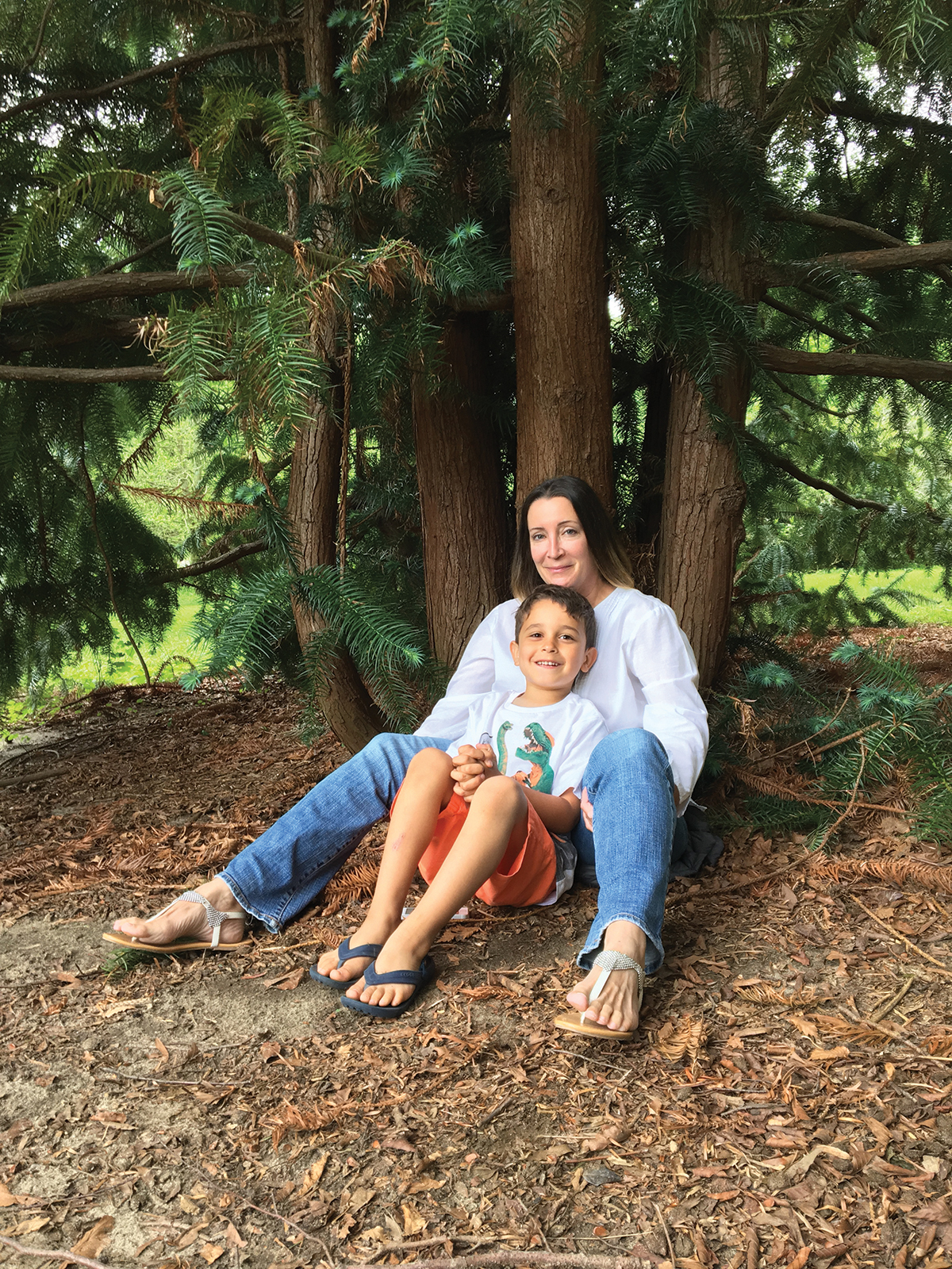 FEELING AT HOME  Mom and Max at the arboretum in Holmdel Park, NJ. Max thinks we need to save as many trees as possible, and not cut them down. We couldn't agree more.