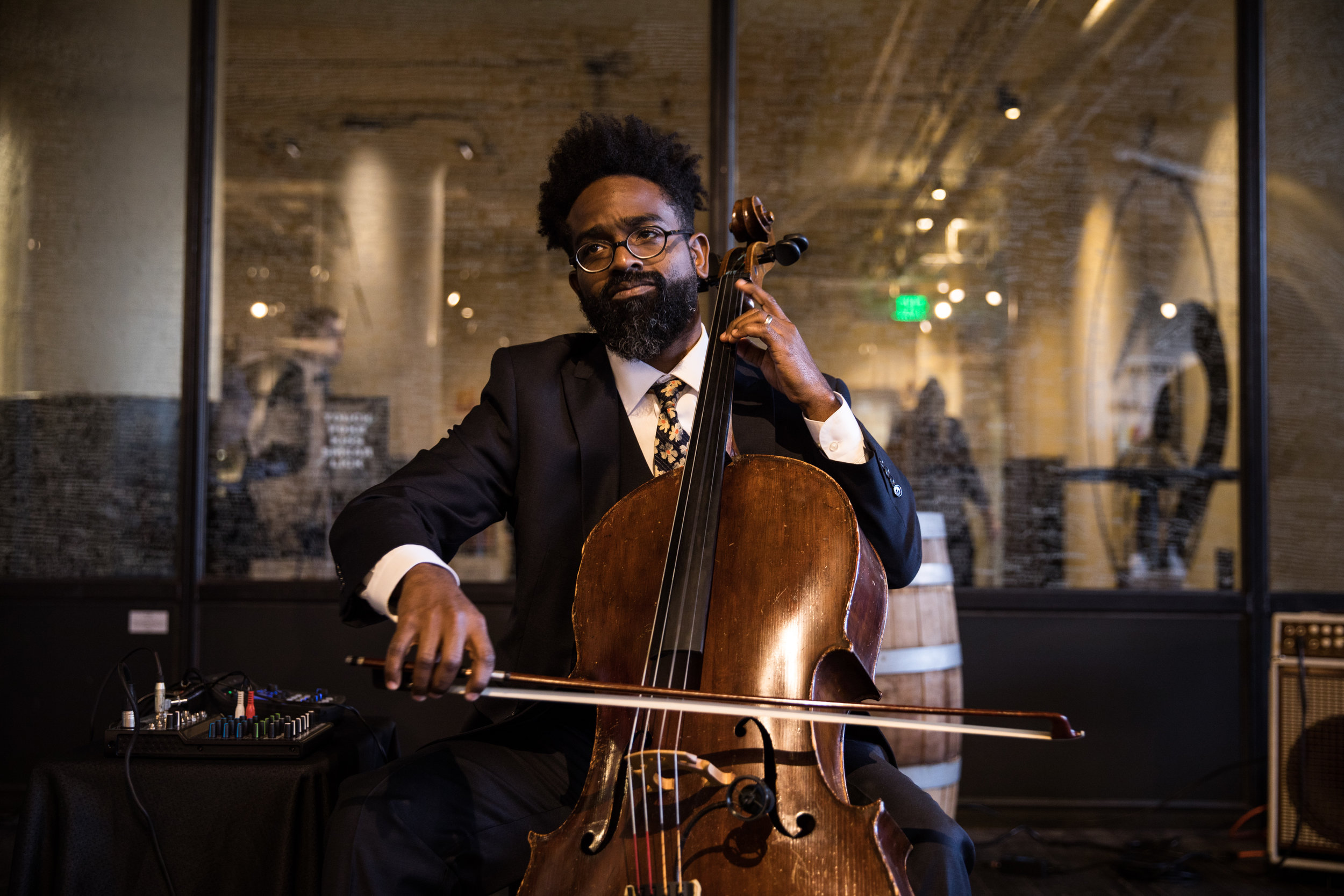 Cellist dressed in stylish suit