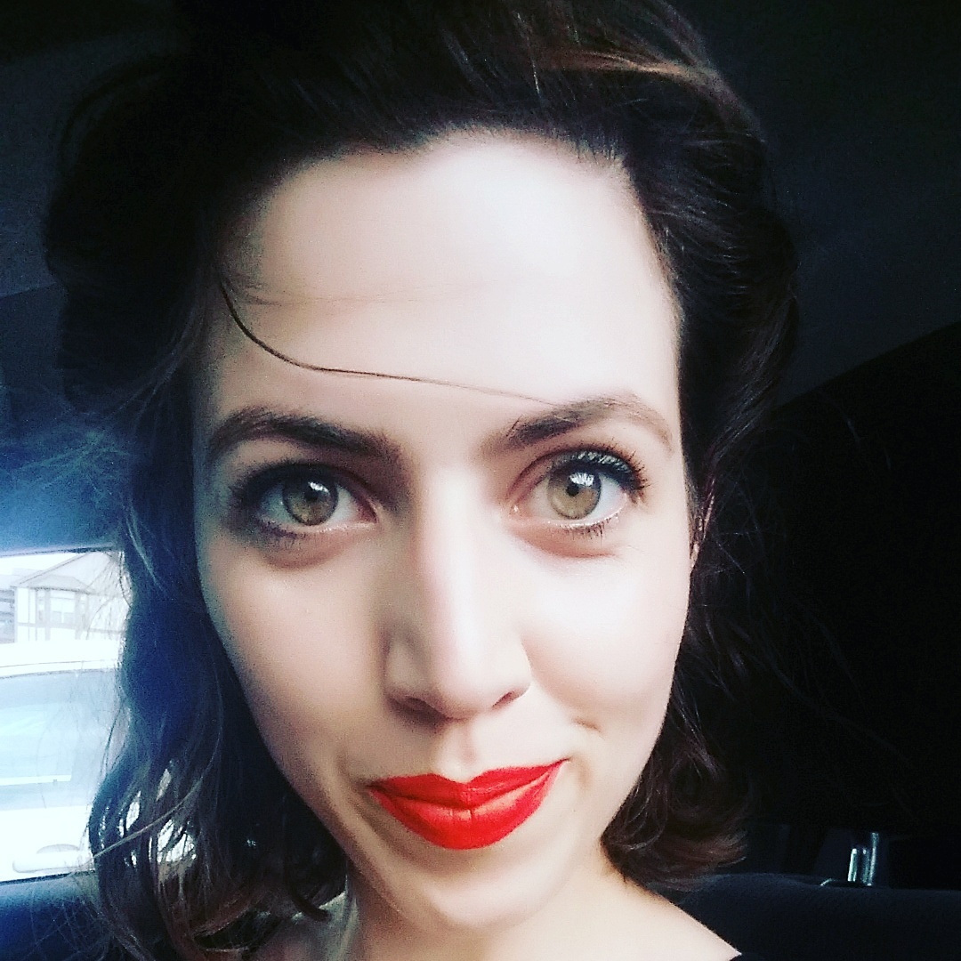 Pictured above: Belle beauty and the beast little wisp of hair on my forehead (that scene where she grabs the beast from falling off his castle in the rain) Also,  Red lips for days (seriously this lipstick is so hard to get off)