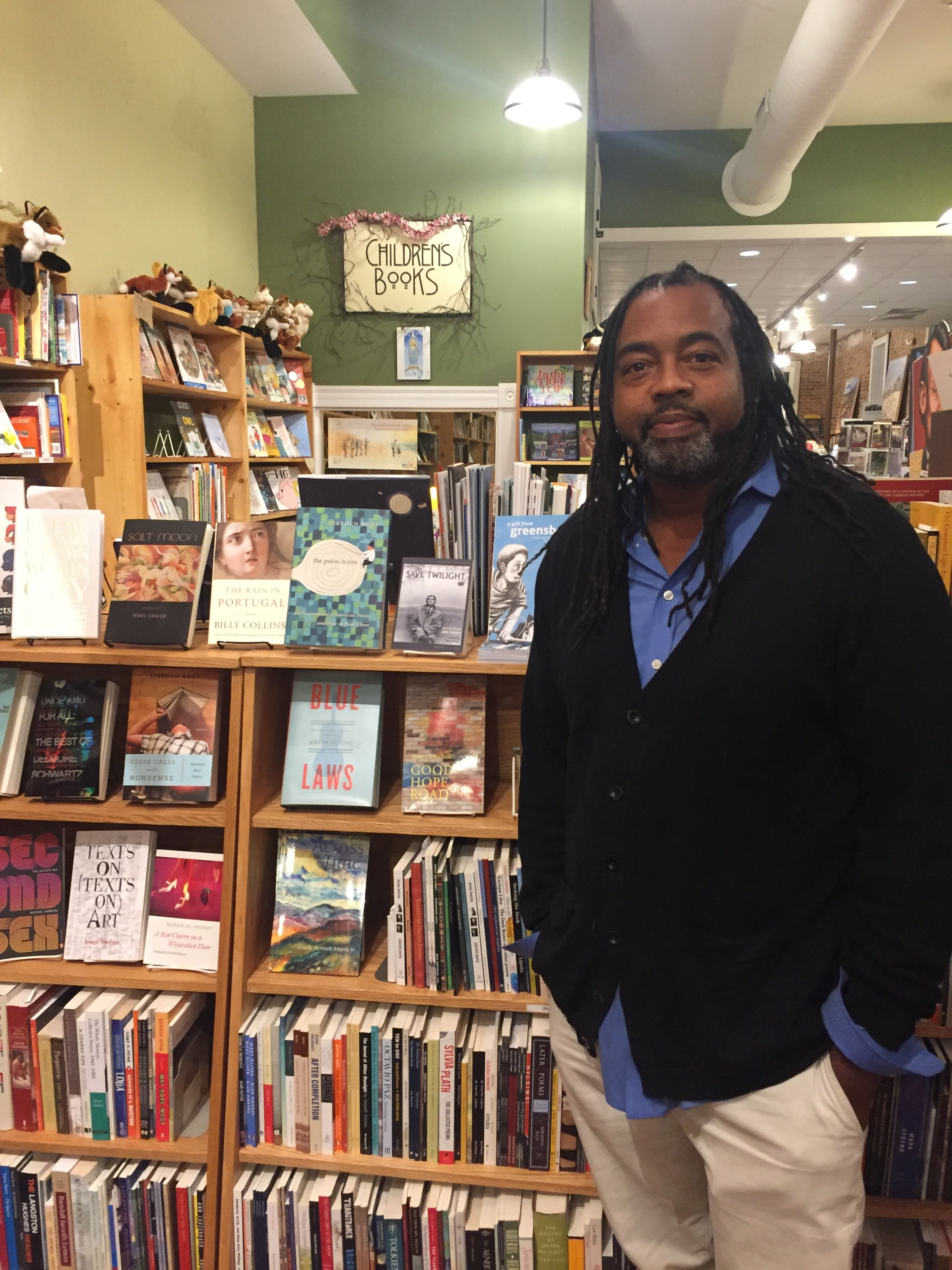 Quraysh Ali Lansana at Scuppernong Books in Greensboro.  A Gift from Greensboro  is peeking out from behind him.