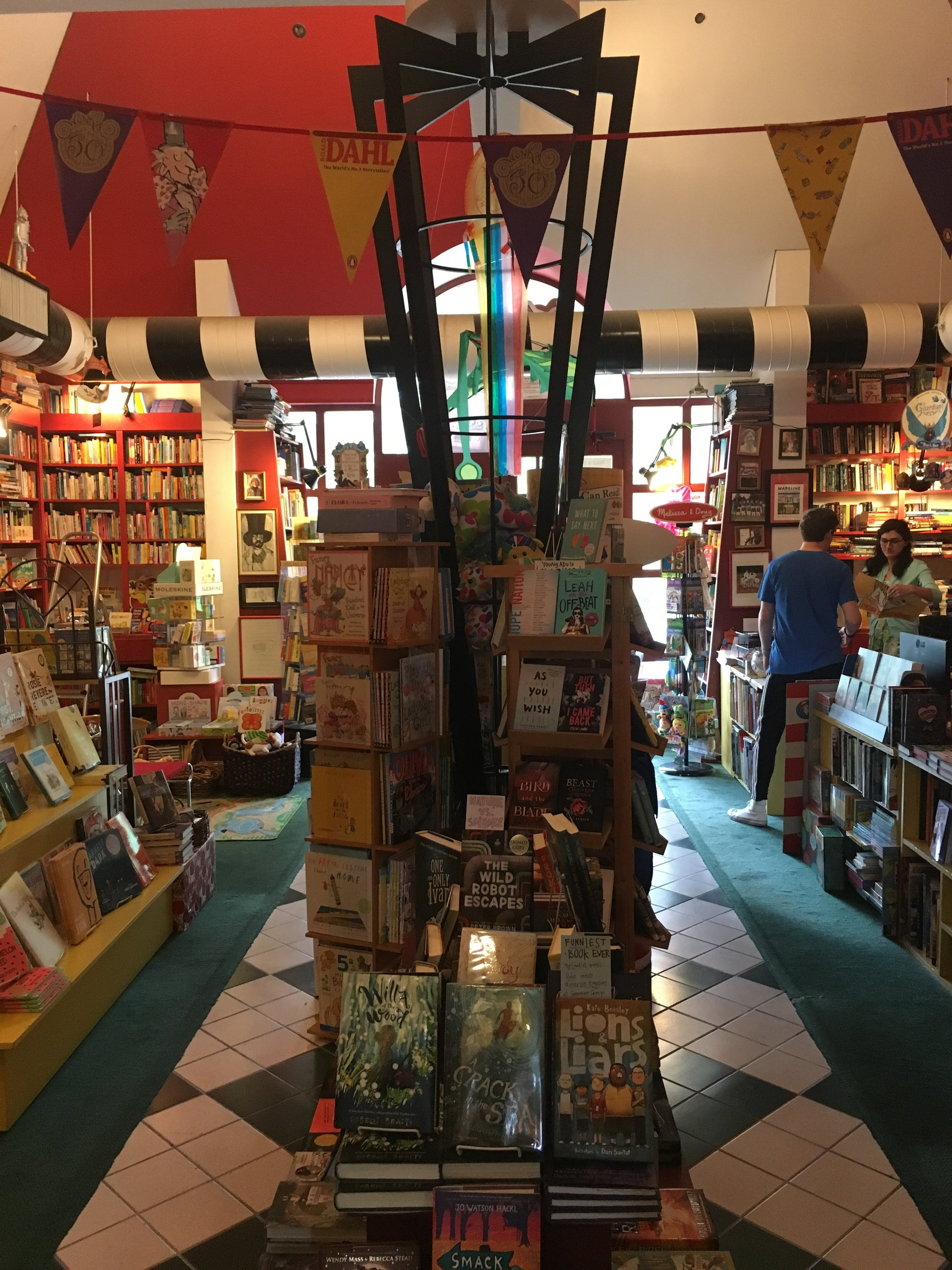 Clara Martin helping a customer at Lemuria Books in Jackson, MS.