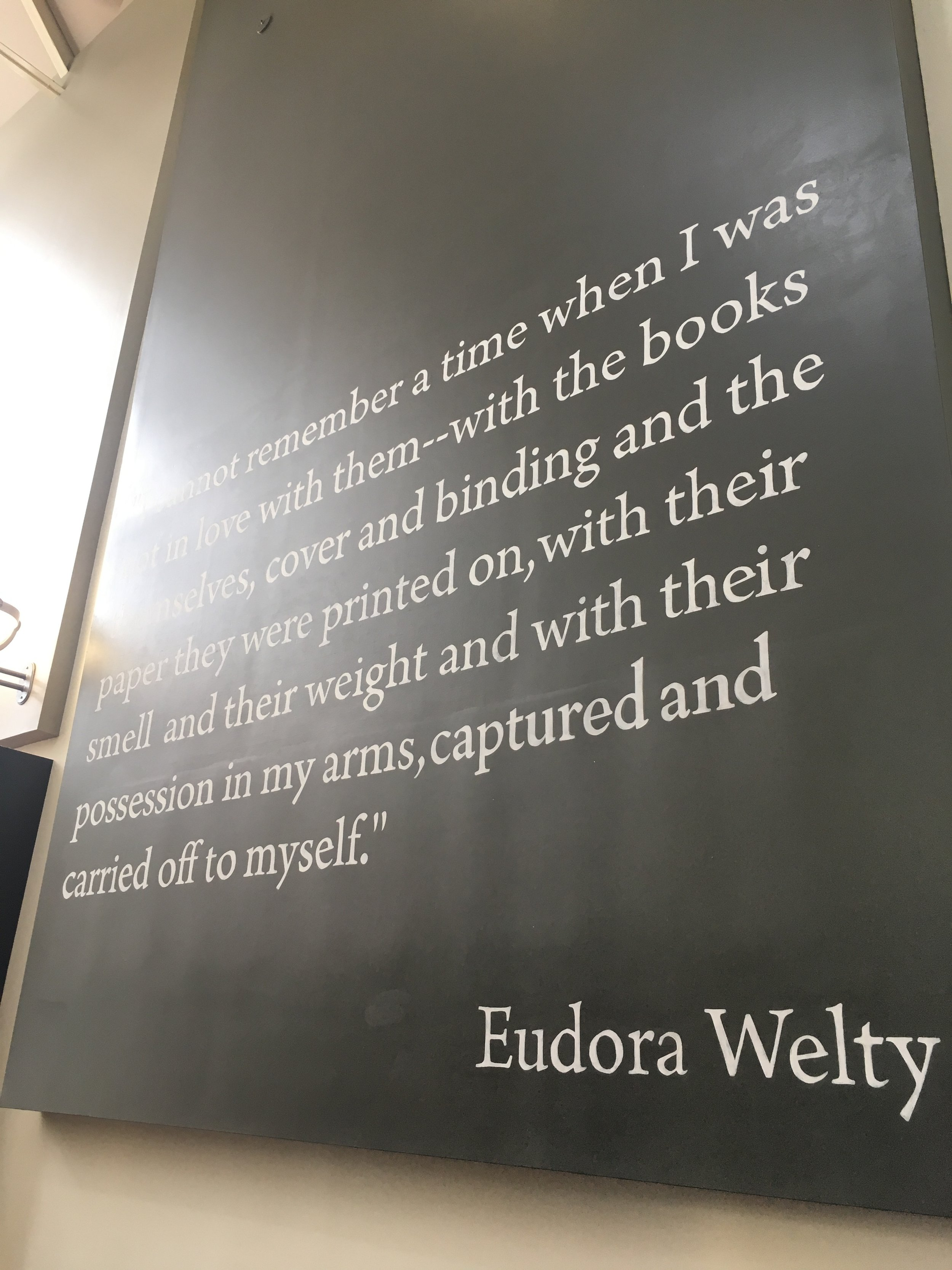 Eudora Welty quote hanging on a wall outside Lemuria Books.