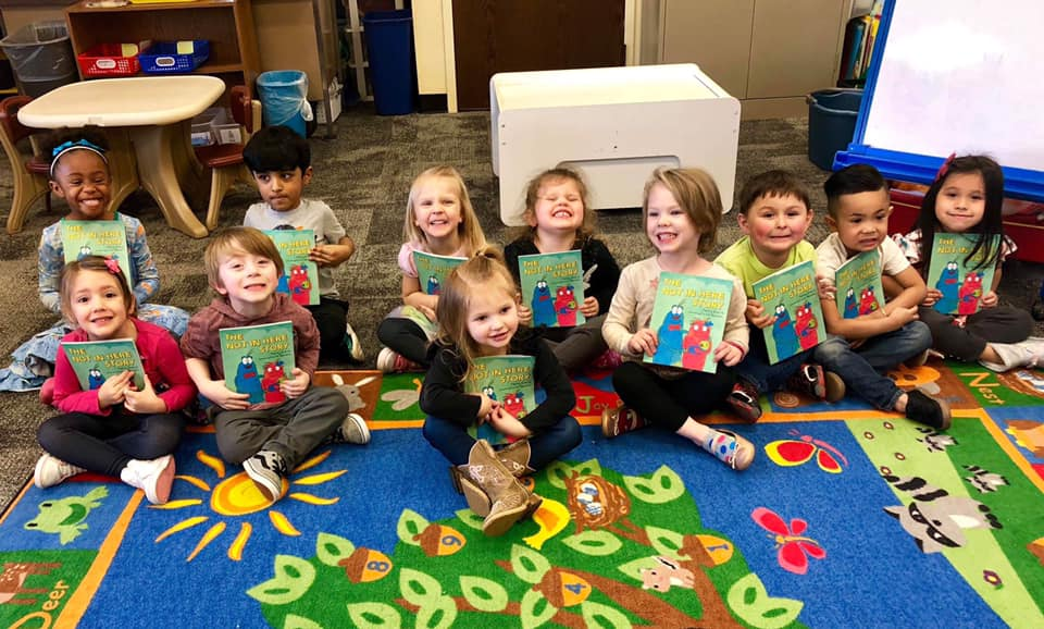 Brooklyn, second row at left, with her classmates and their copies of  The Not in Here Story .