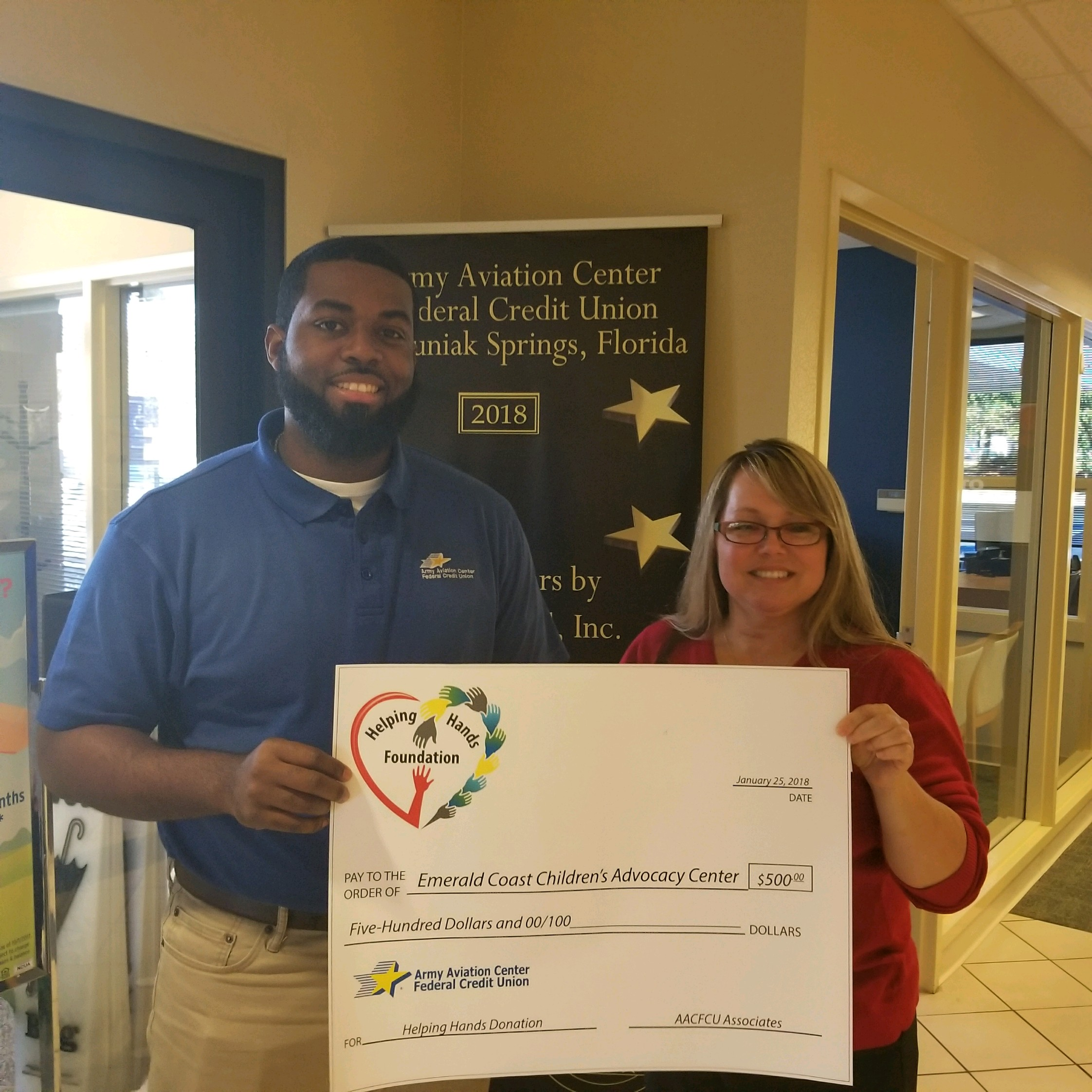 ECCAC receives $500 donation from Army Aviation Center Federal Credit Union   employees D'von Campbell and Jill Russell.