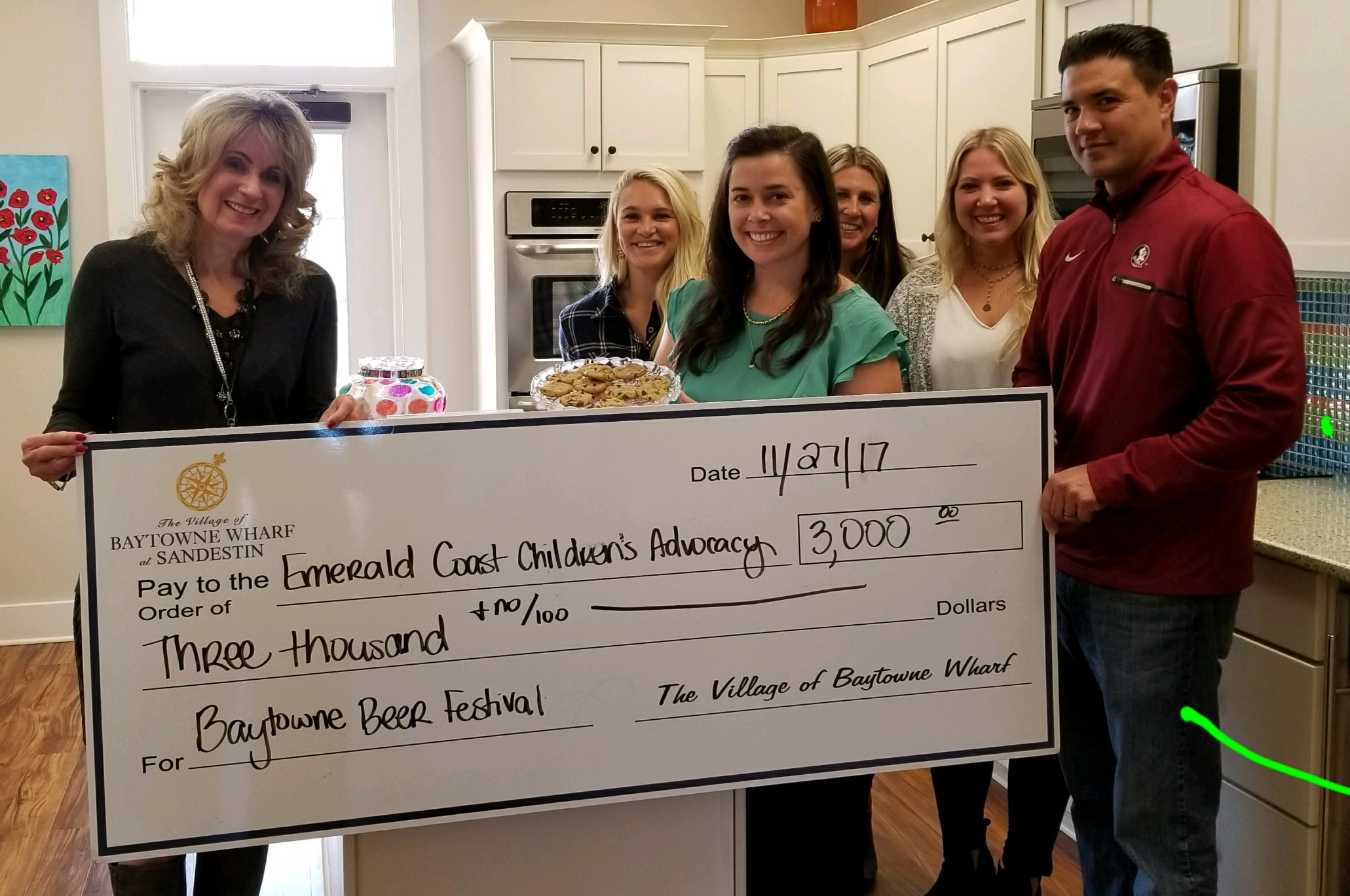 Baytowne Wharf at Sandestin staff at ECCAC's DeFuniak Springs location to present a $3,000 check   to the non-profit organization from their Beer Festival event.    L-R Julie Hurst, Chelsea Fox and Kim Henderson from ECCAC with Julie Stuckey, Leighann Elliott and Alan Meyers from Baytowne.