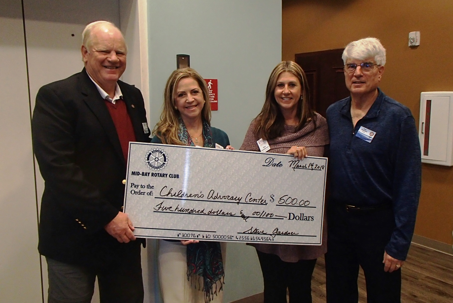 ECCAC receives $500 donation from the Mid Bay Rotary Club. Pictured L-R are  Steve Gardner, Katrina Puri, Kim Henderson and Tom Ockunzzi.