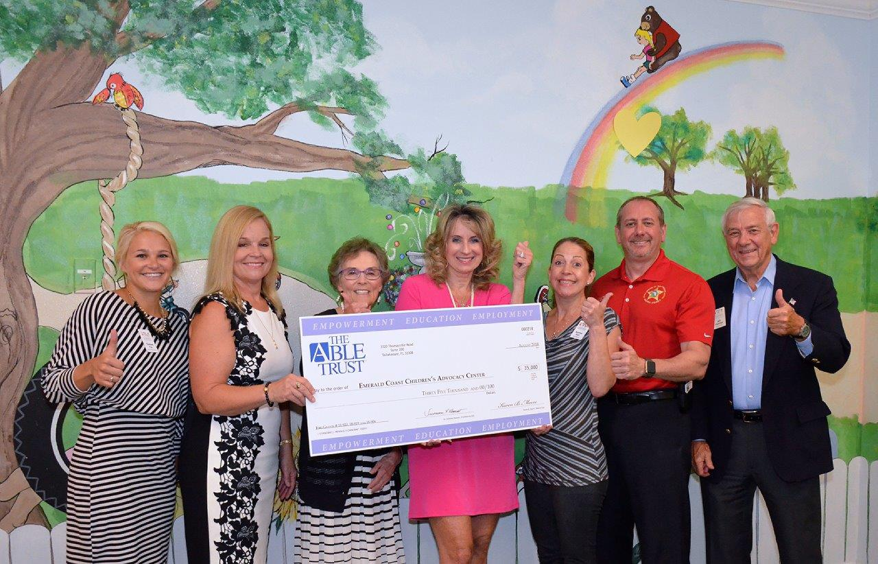 The Able Trust awarded a $35,000 grant to the Emerald Coast Children's Advocacy Center. (L-R) Chelsea Fox, Nancy Kline, Dr. Susanne Homant, Julie Hurst-Porterfield, Katrina Puri, Major Audie Rowell and Bill Fletcher gathered for the check presentation.