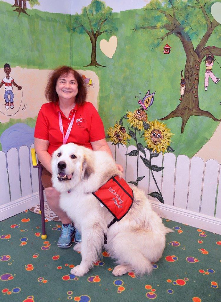 Lisa Dunphy with her Great Pyrenees, Tiny.