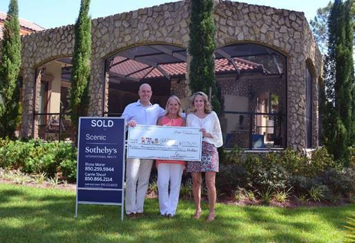 Scenic Sotheby's International Realty generously donated over $13,000 of their commission to the Pierce Family Children's Advocacy Center in Walton County.  L-R: Blake Morar and Carrie Shoaf, with Scenic Sotheby's and Julie Hurst-Porterfield, CEO ECCAC