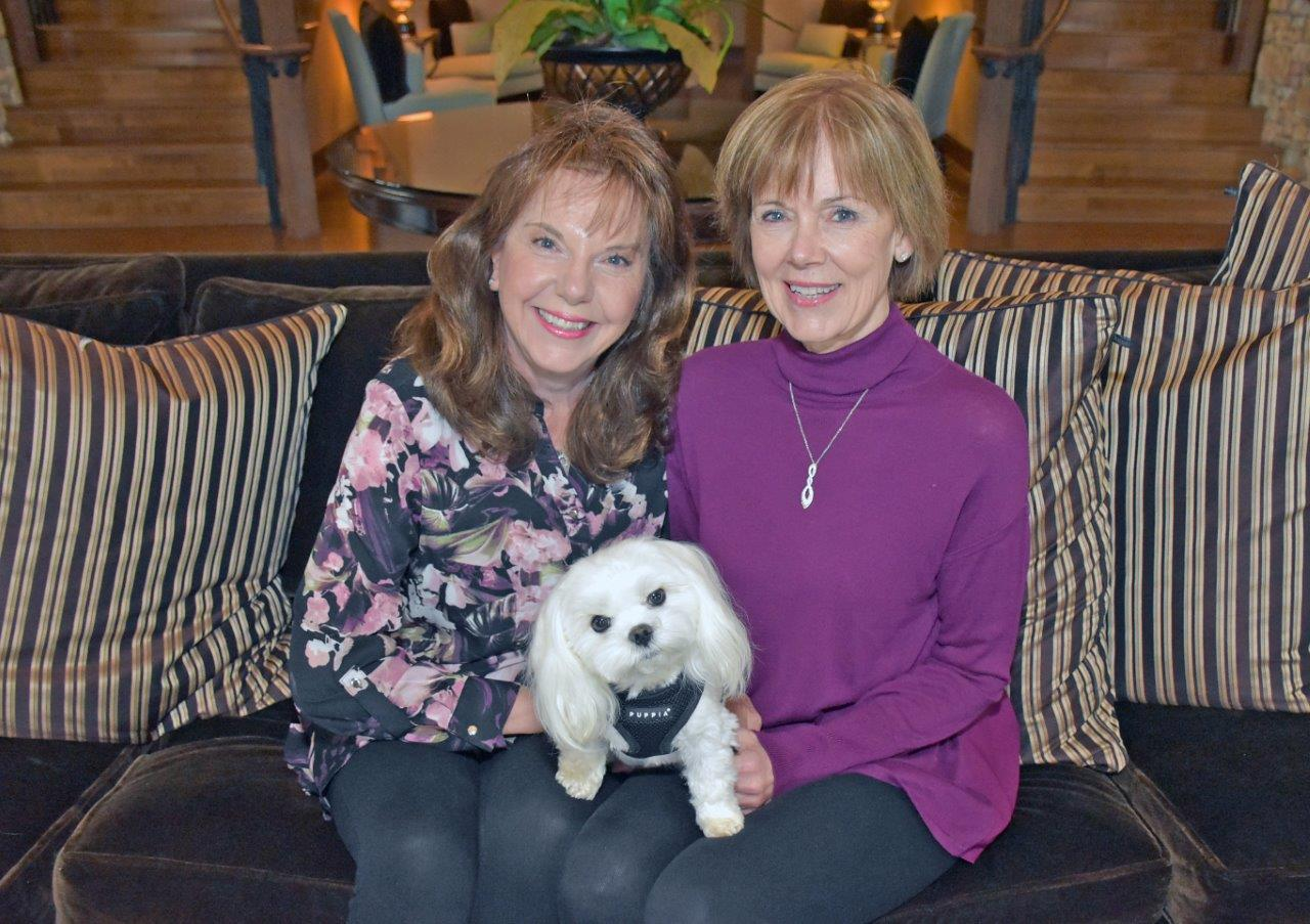 Abbey, the 4-year old Maltese therapy dog for ECCAC and VPS airport, with owner/handlers Roslyn Lindeman and Jennifer Town.