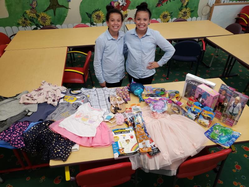 This is Gabriela and Graciela Mercado. In lieu of receiving gifts for themselves at their 12th birthday party, they asked their friends to bring gifts for ECCAC children. Mom says the girls have grown up knowing about the Center from a young age and frequently donate their dresses they have outgrown to us!