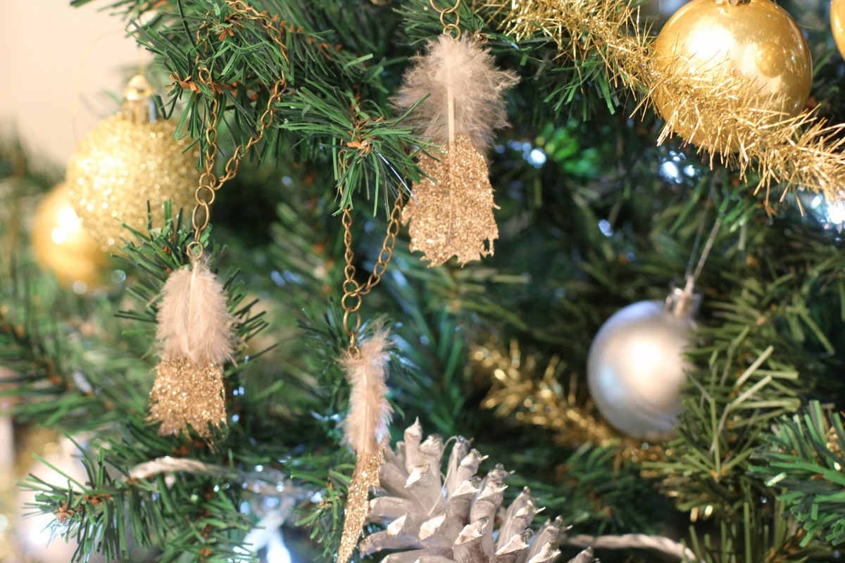 Glitter Feather Ornaments -- So delicate! They kind of add a fun boho/glam vibe! love.