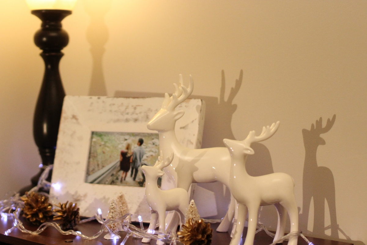 Deer Figurines // Twinkly Lights //  Frosted Trees   I'm really into reindeer/antler everything this season! They're so classic and playful. I love these figurines and they go great on a bookshelf or as a centerpiece!