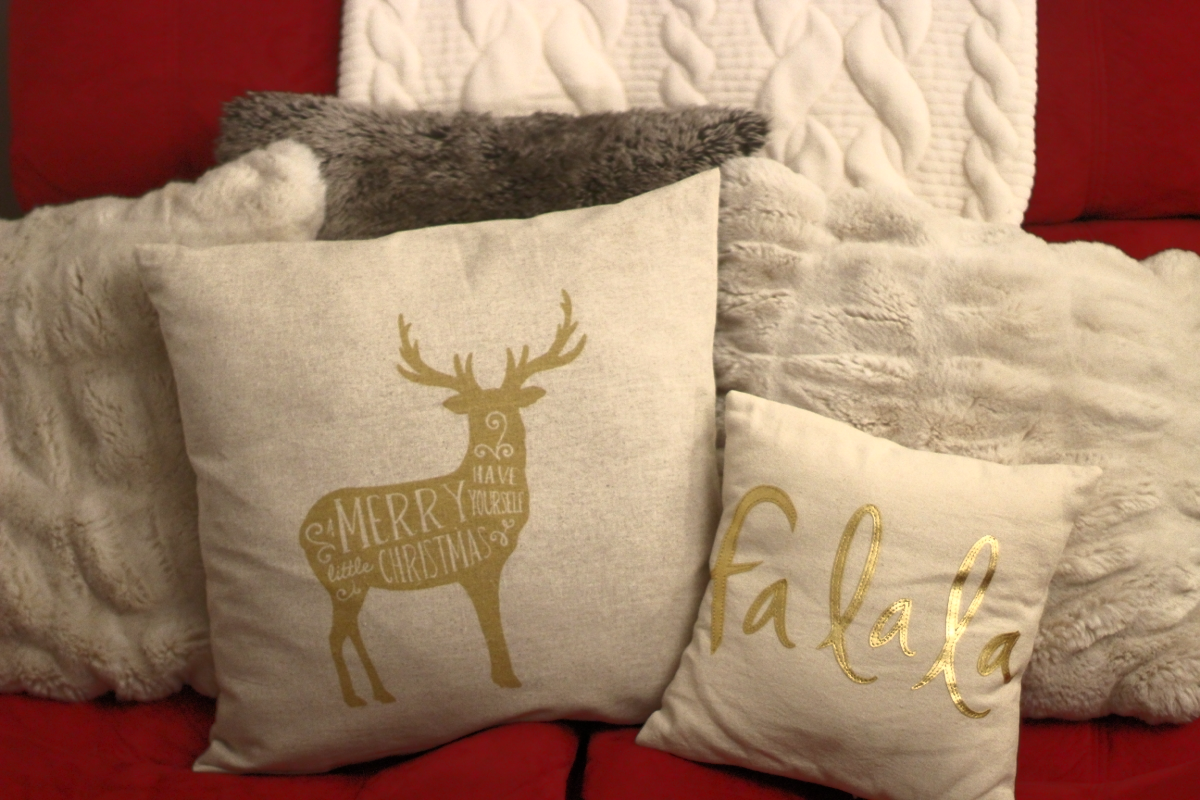 Kinda works out perfectly that our couch is red! These pillows were the perfect addition. So festive!  Fa la la Pillow // Reindeer Pillowcase