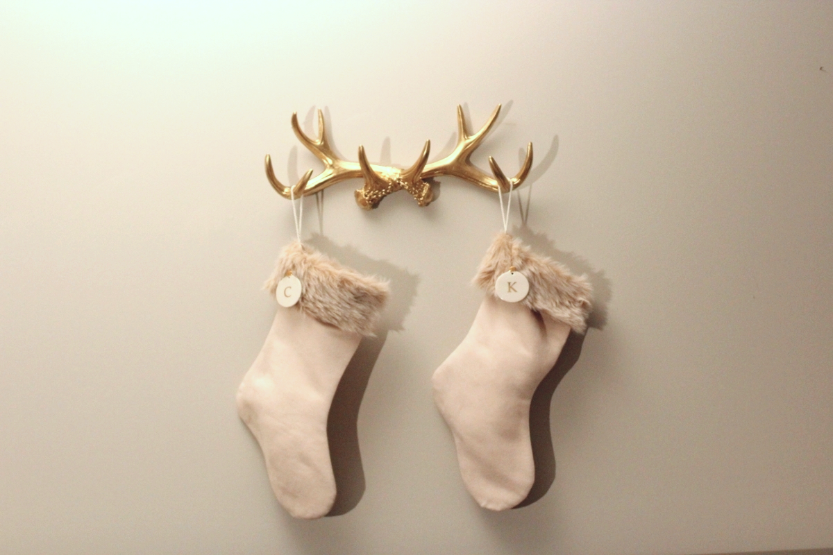 Stockings // Antlers // Ornament   I really wanted to hang stockings but we don't have a fireplace. #STRUGGLE. But these antlers saved the day! Literally so perfect. I hung them above our TV and you can play a Netflix video of logs burning.. so we basically have a fireplace now.  ALSO! You can use code THANKYOUTHANKYOU for 25% off these antlers! woo!