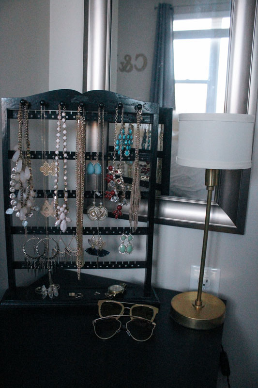 This  jewelry stand  is amazing! I've probably tried a million ways to organize my jewelry and I finally found one that works. There is a place for necklaces, earrings, aaand a tray for rings/bracelets. I found it on Etsy and it has really helped me stay organized.