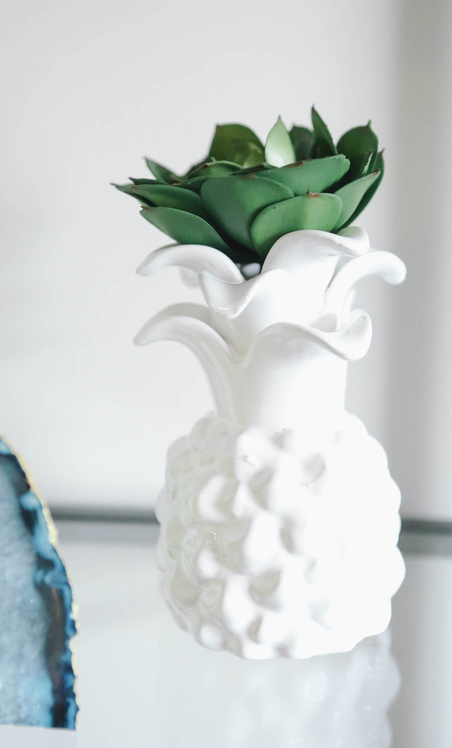 I popped a little faux  succulent  on top of this  pineapple vase  to complete the pineapple look. Cort keeps making fun of me for my current pineapple obsession. He's like seriously, another pineapple. But I love them!