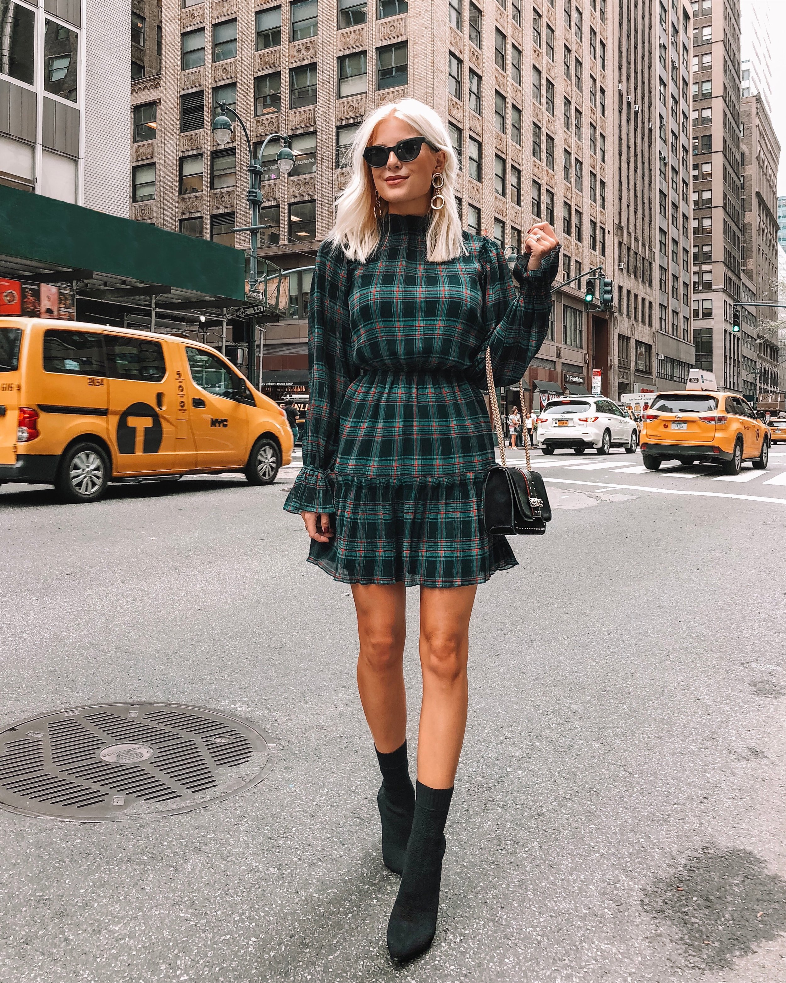 Rad in Plaid - This dress was a huge crowd fav for y'all. It's from Lesley Jane Boutique. I'm wearing a size small. True to size. Also, LOVING the sock bootie trend!