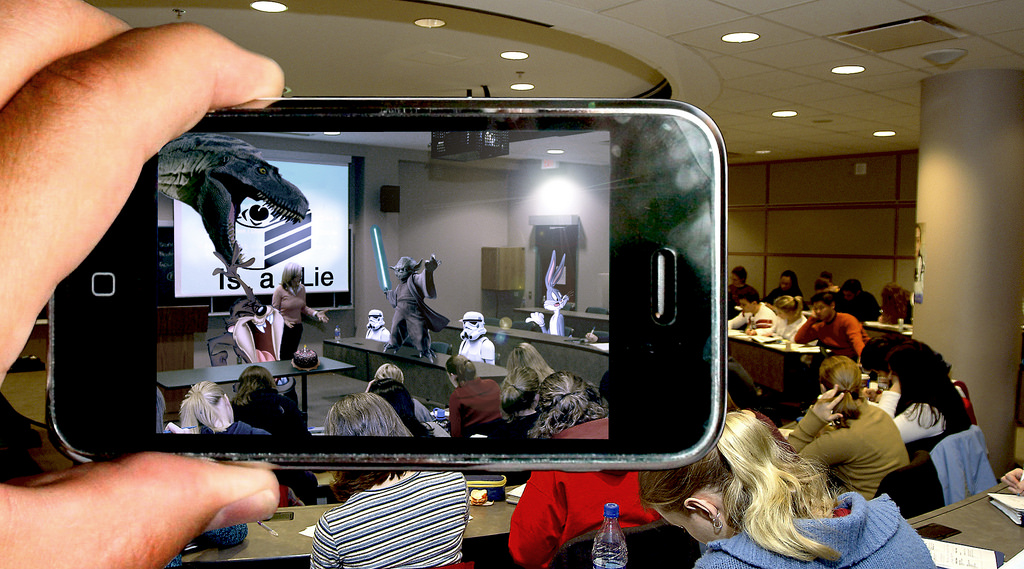 """Augmented reality is """"a technology that superimposes a computer-generated image on a user's view of the real world, thus providing a composite view."""" (Photo by  Tom on  Flickr ; Licence )"""