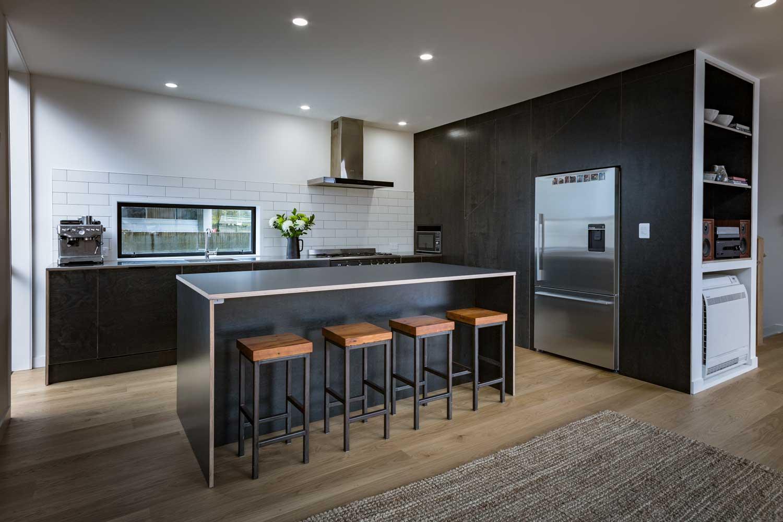 Black plywood kitchen island bench
