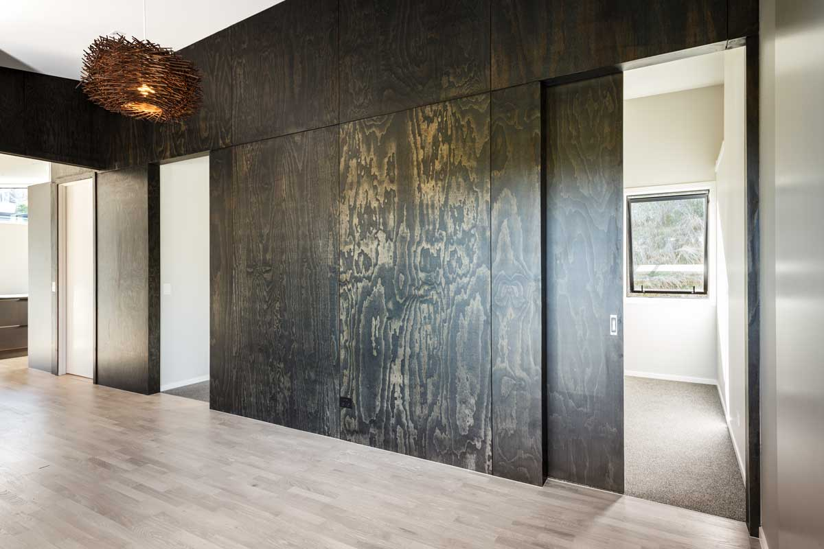 plywood black feature wall