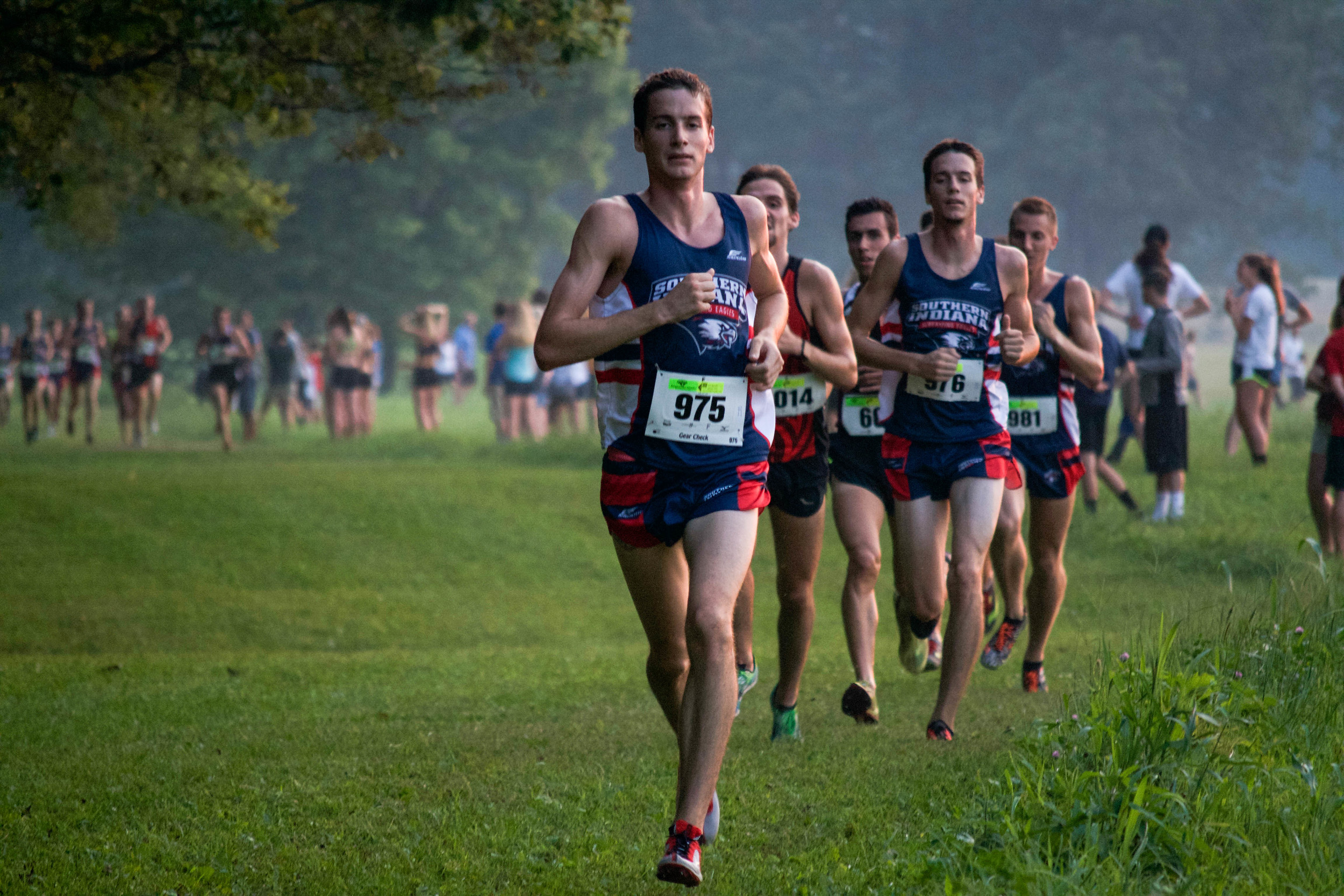 Johnnie Guy, a senior engineering major, leads the pack during the Stegemoller Classic in which the men's cross country team finished first at the beginning of the season. Their success this year led to coach Hillyard being named coach of the year.  (Shot for The Shield)