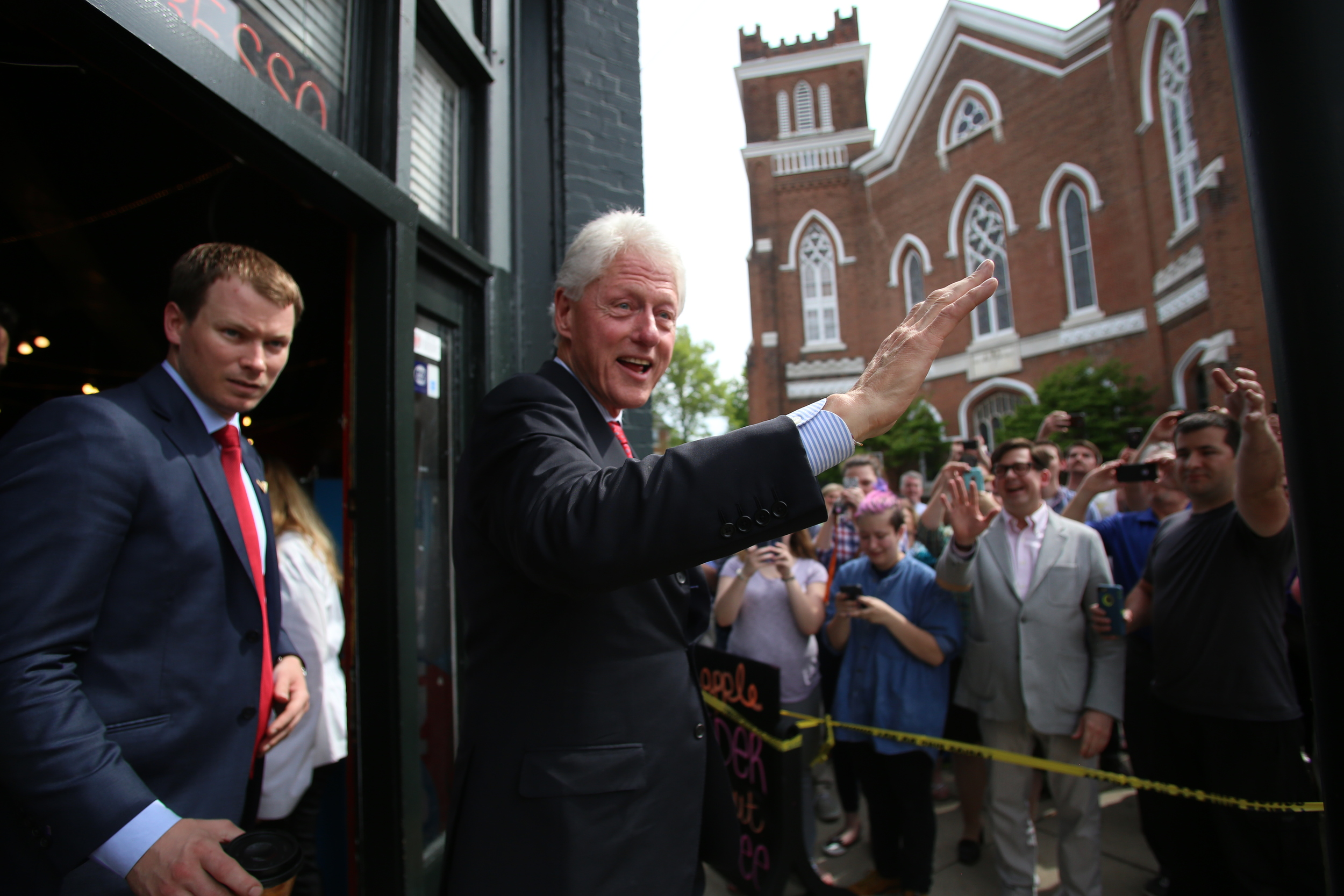 Former president Bill Clinton waves to the crowd April 26 as he exits Penny Lane Coffee House, one of his two stops in Evansville while his wife and democratic presidential candidate Hillary Clinton visits Mishawaka, In.  (Shot for The Shield)