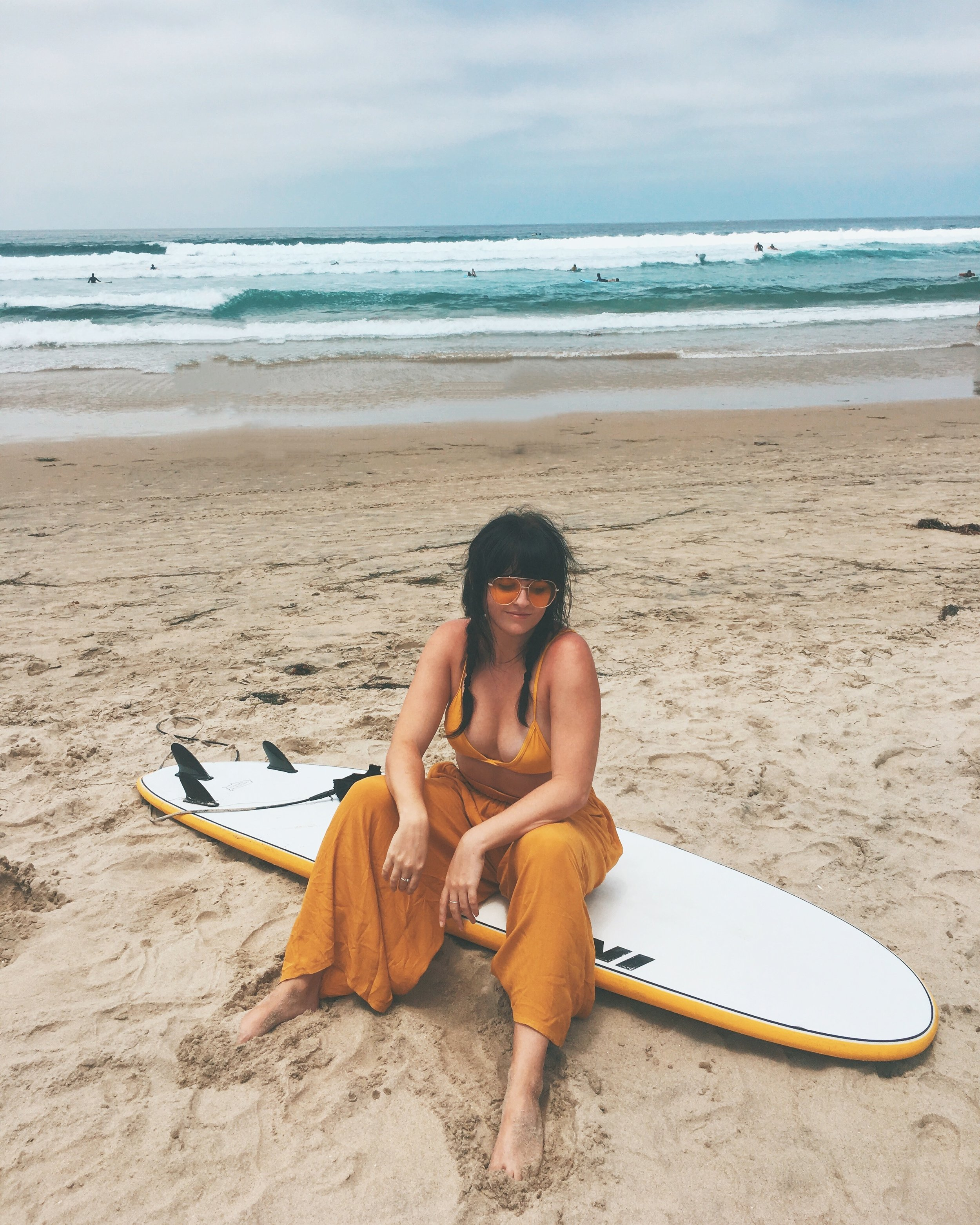 His surfboard matched my all-yellow outfit so duh I made him take a photo of me.