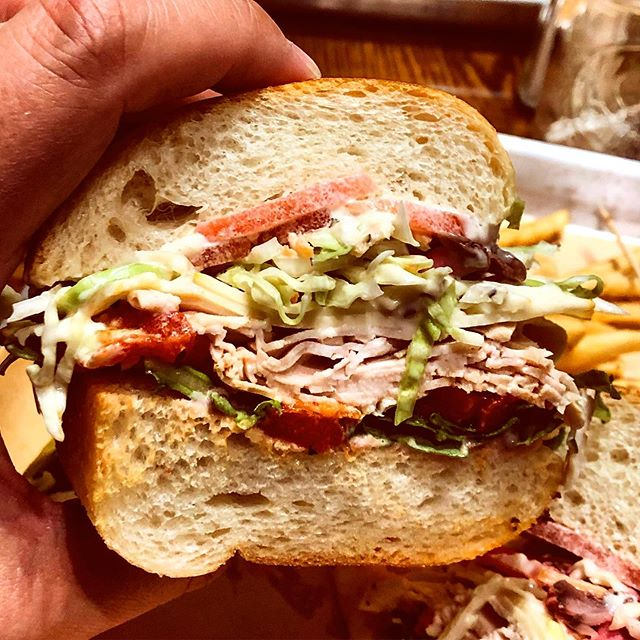 The Elliot Mess from @speakeatery in #AsburyPark: turkey, roast beef, muenster, arugula, roasted red peppers, tomato, coleslaw, cranberry aioli and a horseradish mayo served on an extra soft pan baked hero.  #sandwich #shoreeats #eeeeeats