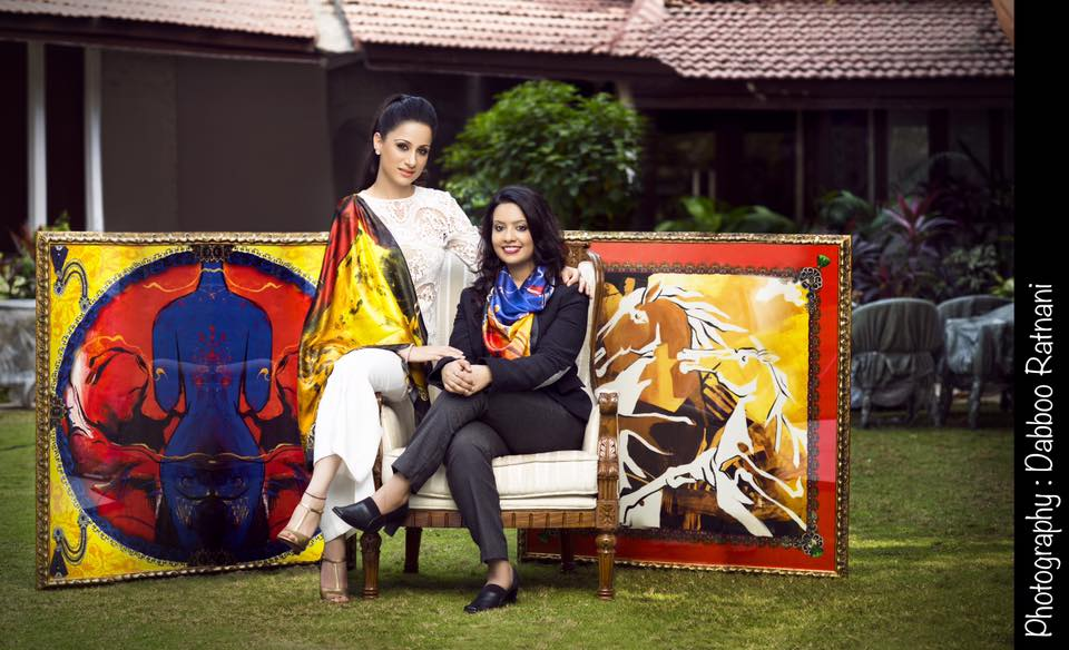 "Oscar Wilde wrote, ""One should either be a work of art or wear a work of art,"" and now muralist and artist Rouble Nagi is presenting us with a chance to do the same.  Rouble Nagi is all set to launch her limited Edition Art scarves. The scarves are versatile and present a range of innovative and unique designs depicting her vividly colourful signature paintings. Celebrating women, the collection features some of Rouble's most iconic works. Rouble's scarves are not only a way to embrace her works physically but also translate something formal and flat into something luxuriously tactile and luscious to the touch.  The artist expressed enthusiasm for the project saying she is happy Amruta Fadnavis is also a part of it.  ""I find Amruta Fadnavis incredibly close to the common woman. Not only is her simplicity appreciable but she is a very inspiring lady. Like lakhs of other working women, she manages to multi task by stepping in roles of a doting mother, wife, homemaker and a professional banker. My collection is for the woman of today, and am happy Amruta is a part of my new series.""  All the proceeds from Rouble's art scarves collection will go for children's education and women empowerment programs."