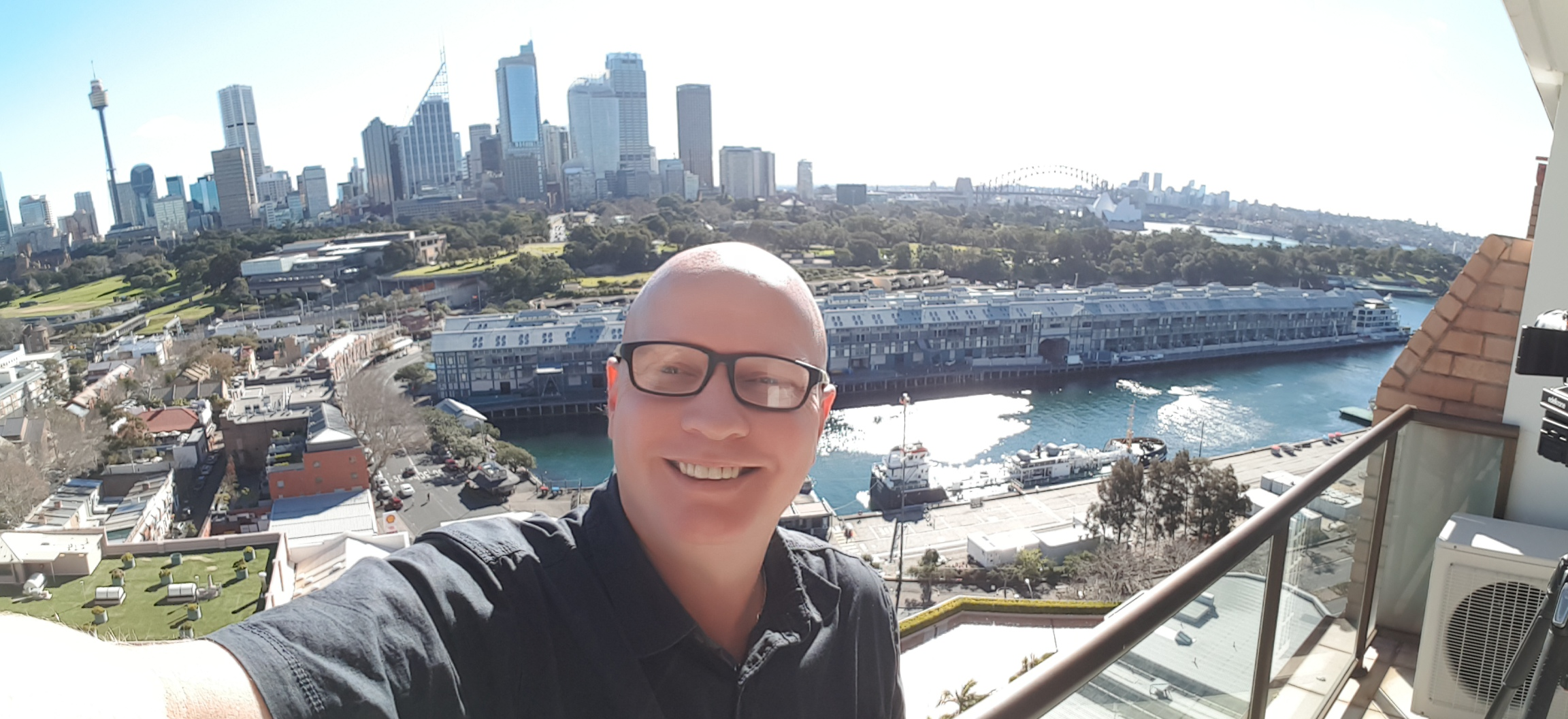 Now that is a million dollar view! Yours truly on the balcony of the prize apartment in Sydney.