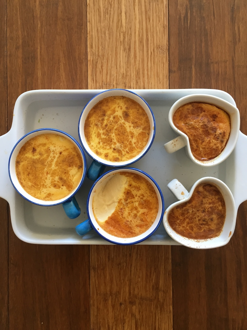 Tea cups filled with creamy baked custard (I couldn't resist but to try)in the baking dish hot water bath.