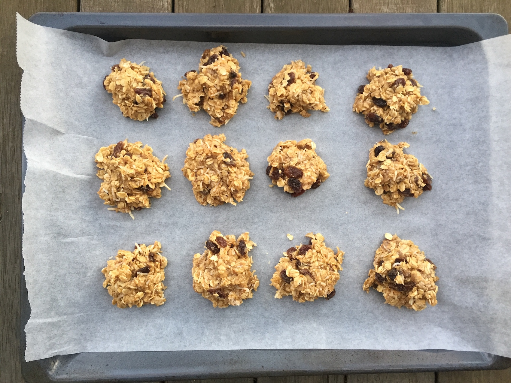 The muesli cookies on the tray before going into the oven