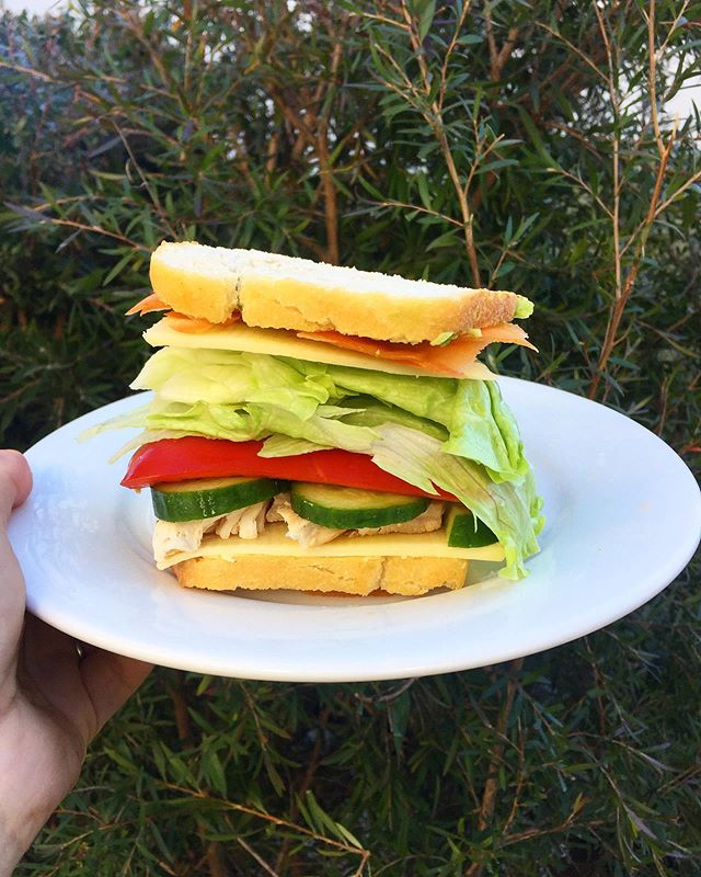 Sandwich perfection - hummus, cheese, chicken, cucumber, capsicum, lettuce, cheese, carrot, avocado on homemade sourdough 👌