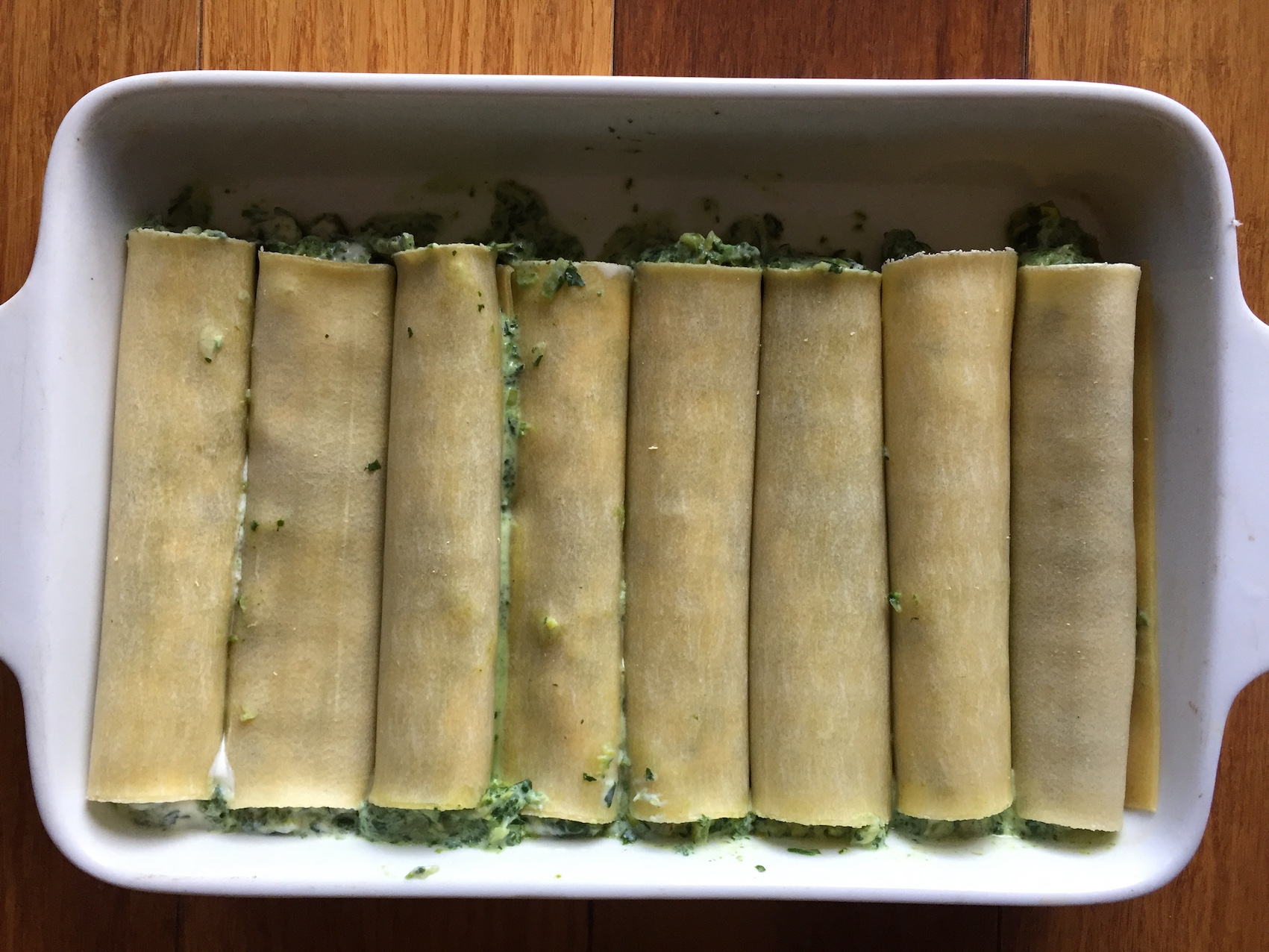 The greens and ricotta mixture wrapped in pasta sheets