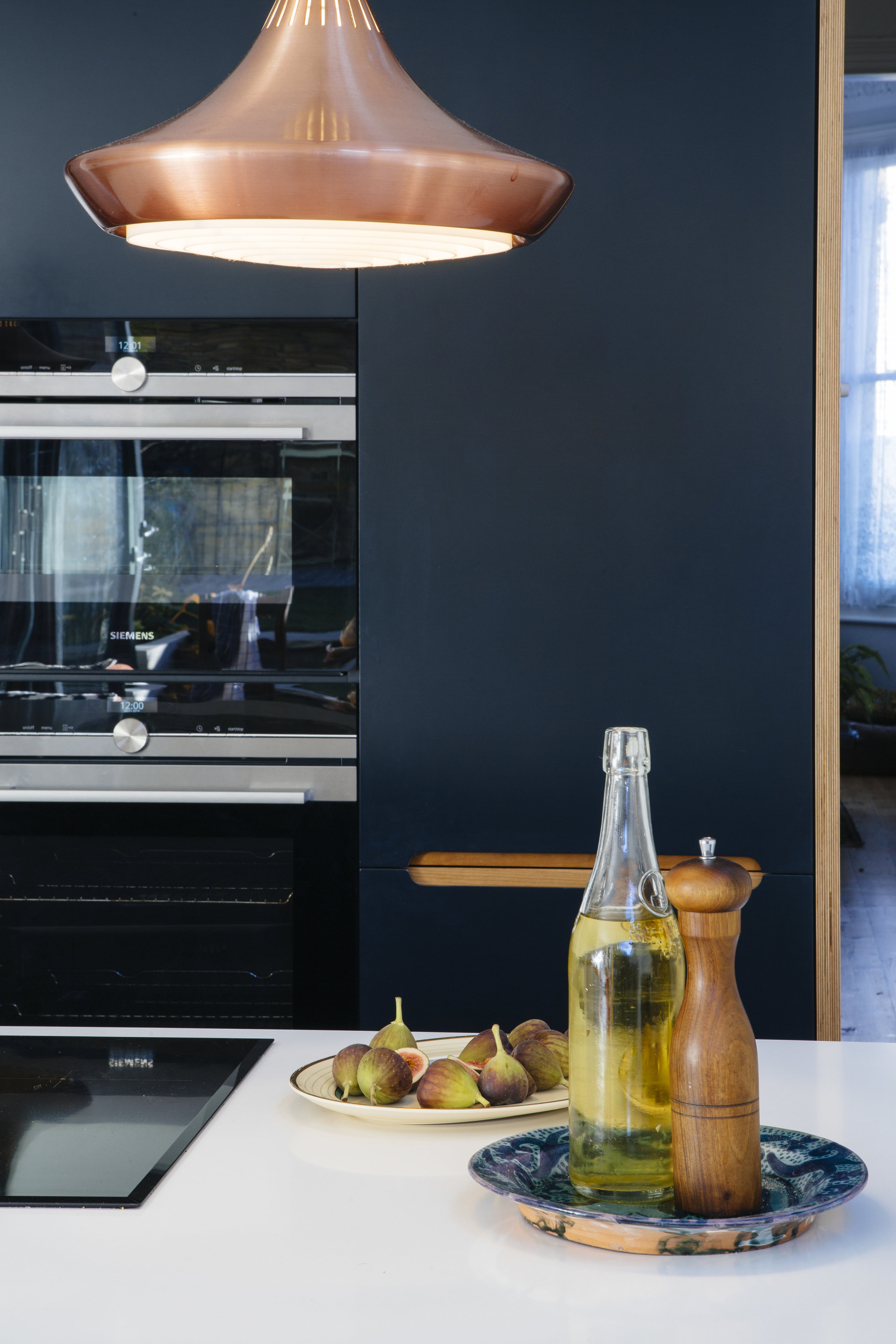 blue wood kitchen doors, matt finish, brass lamp, modern design, london