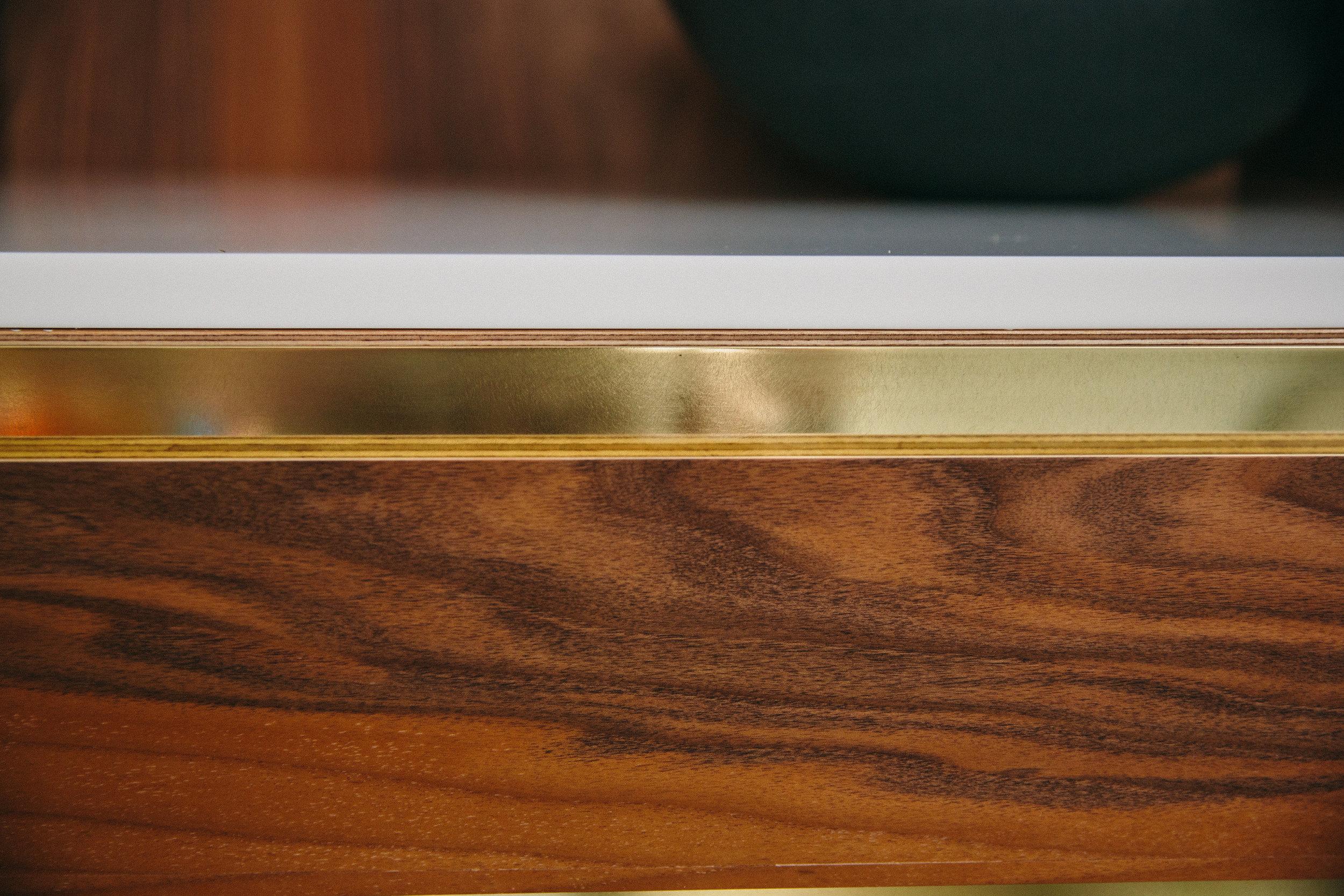 brass detail worktop surface bespoke kitchen